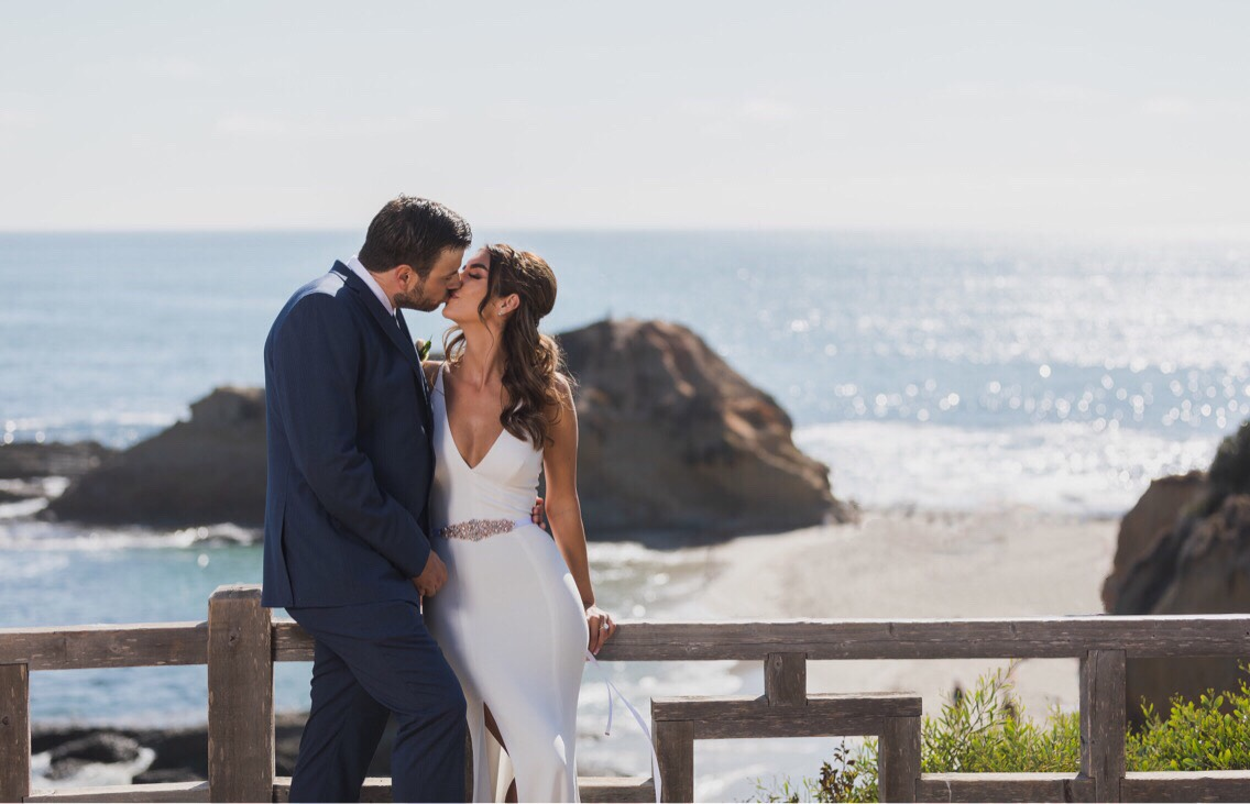 Photo of Wedding Couple Kissing at Treasure Island Laguna Beach.jpg
