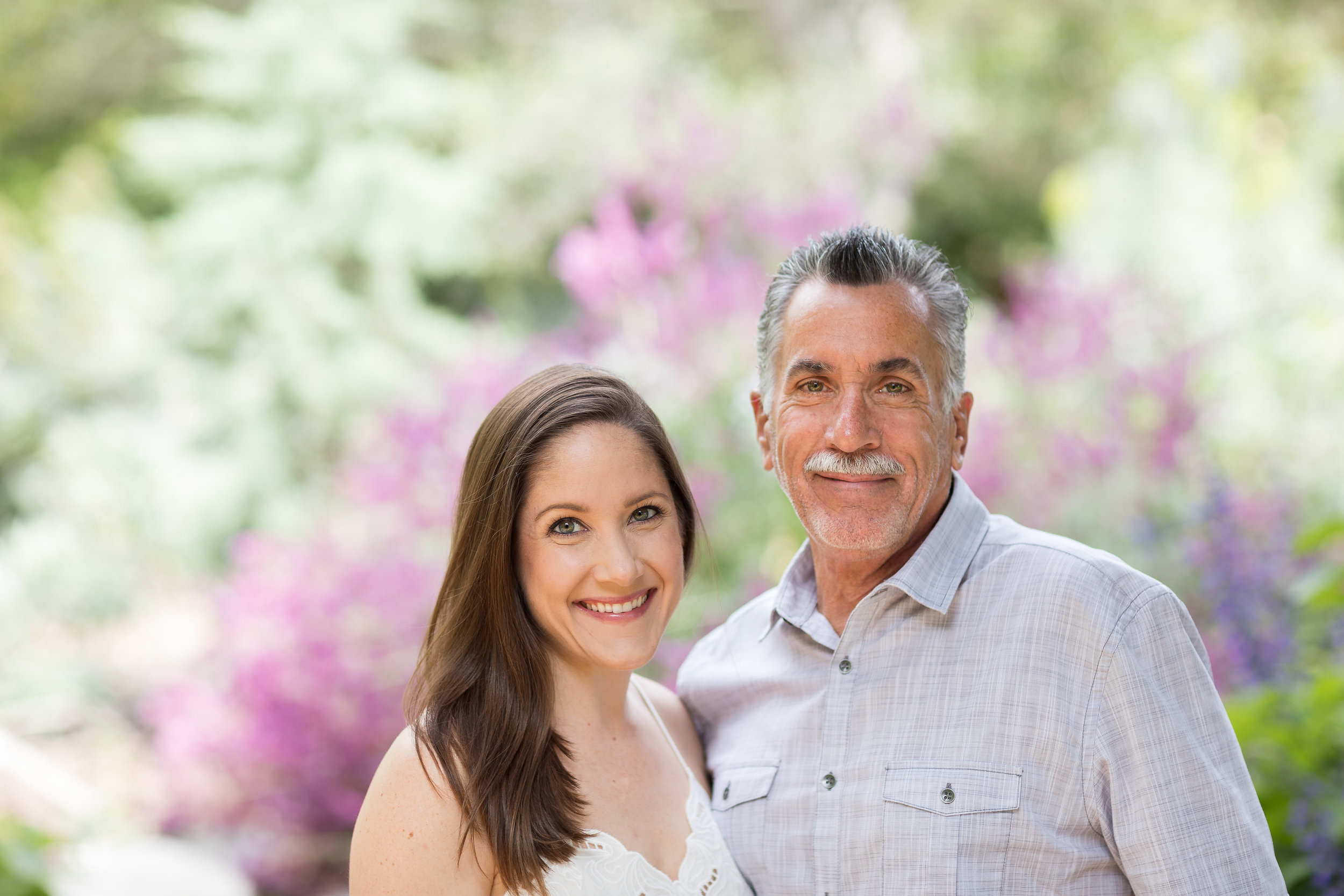 HB Photo of Father and adult daughter in front of garden.jpg