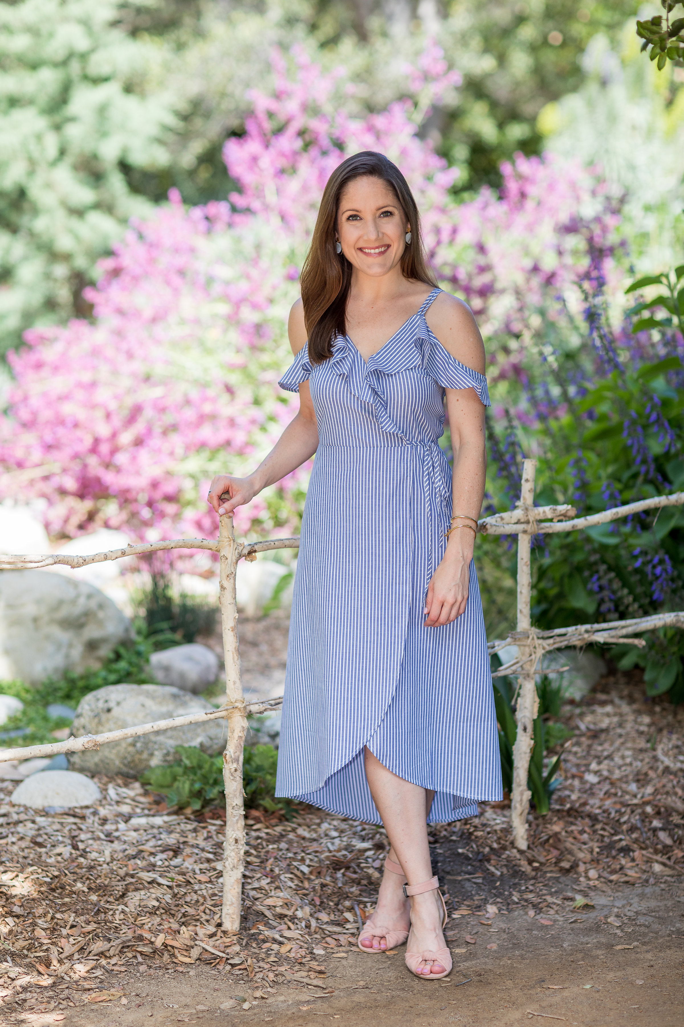 pose idea for adult female in a blue dress in front of a garden.jpg