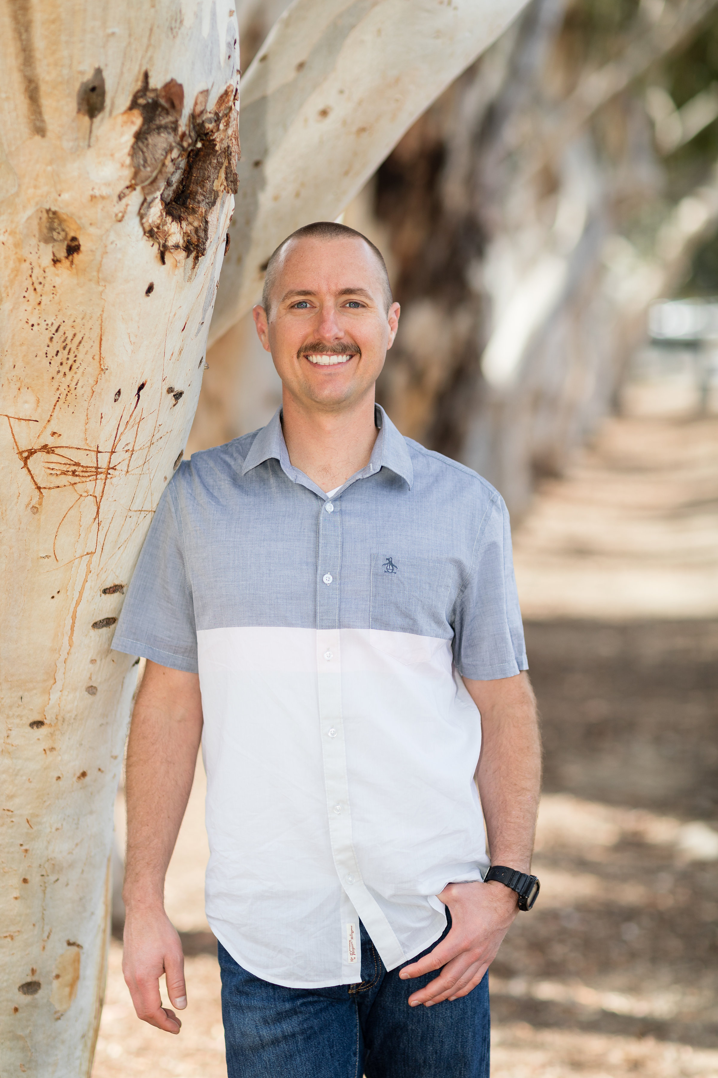 HB portrait of adult male standing by tree.jpg