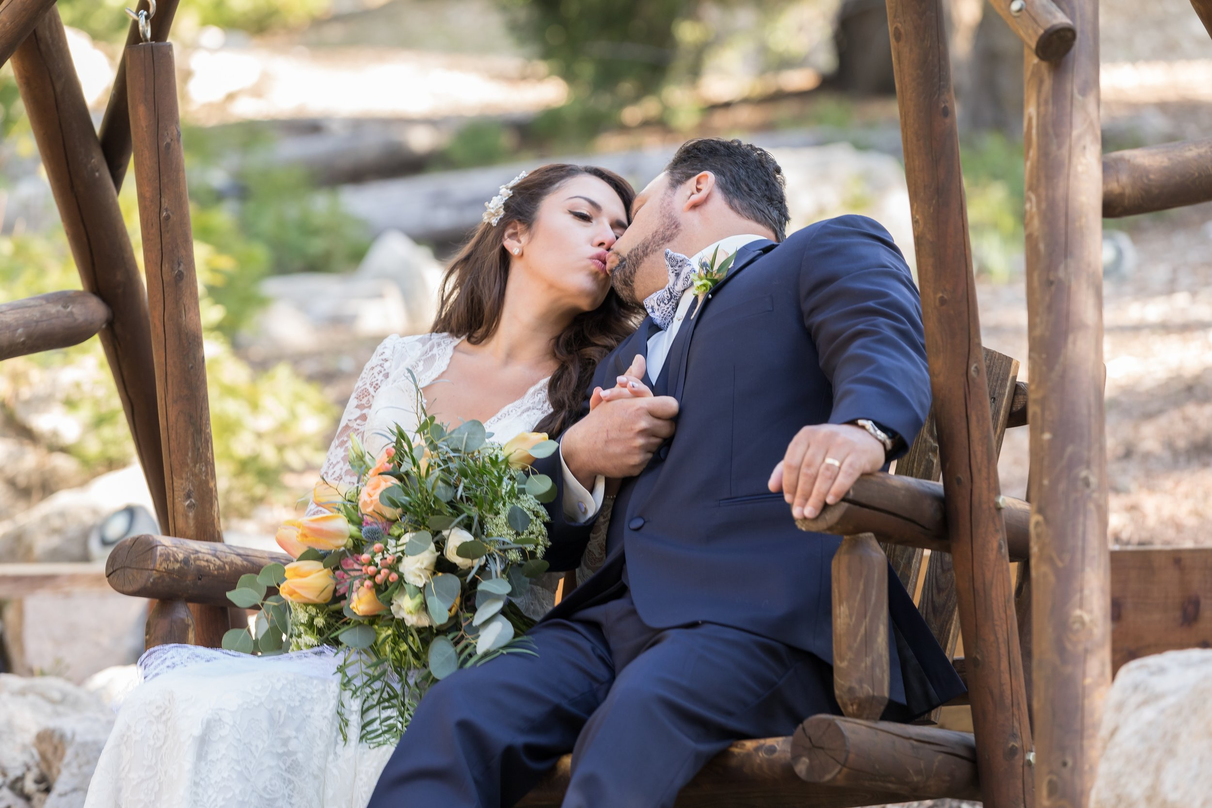 ! Rustic Wedding Photography Kissing on the Swings.jpg