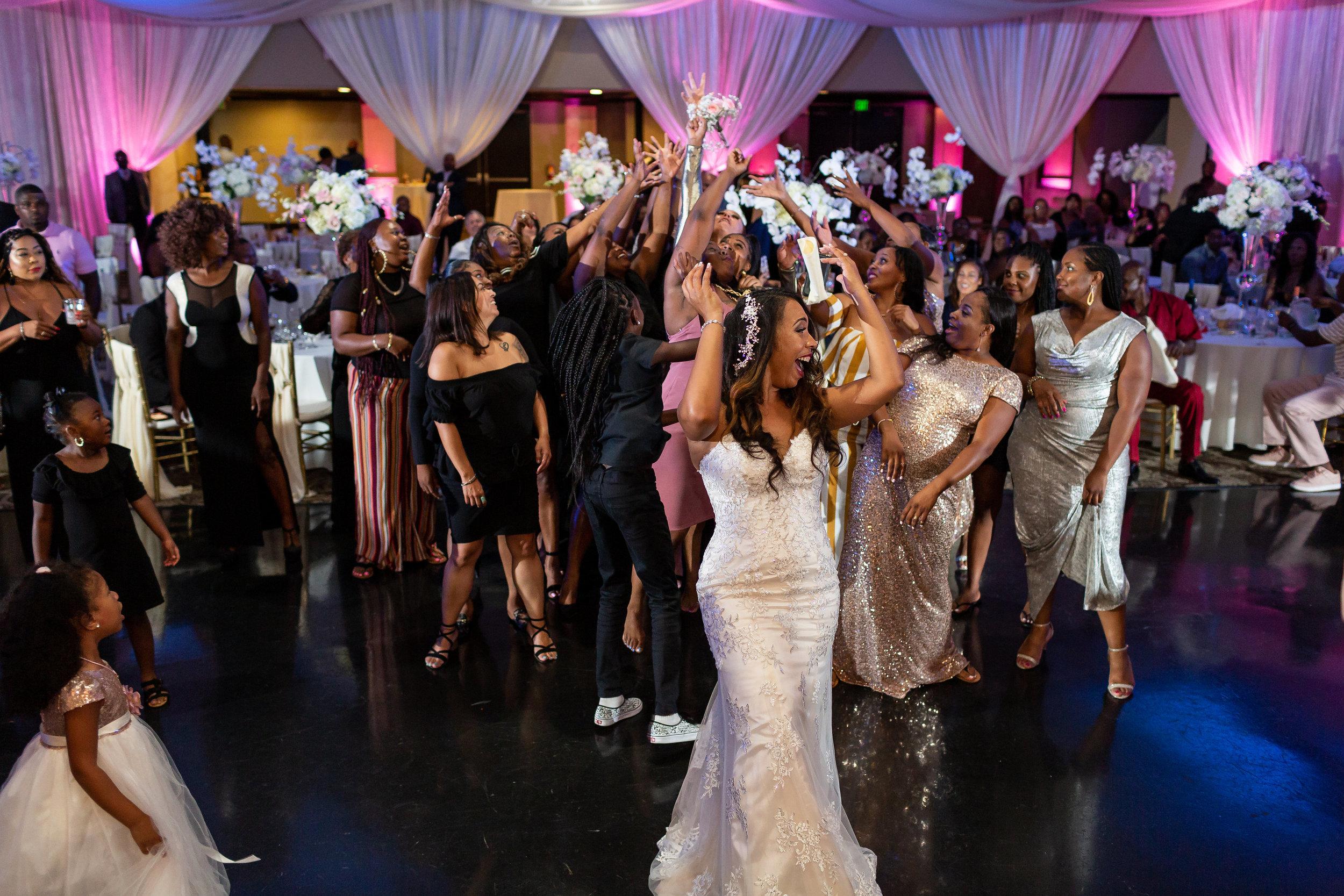 Stunning Bouquet Toss Photo of Long Beach Wedding.jpg