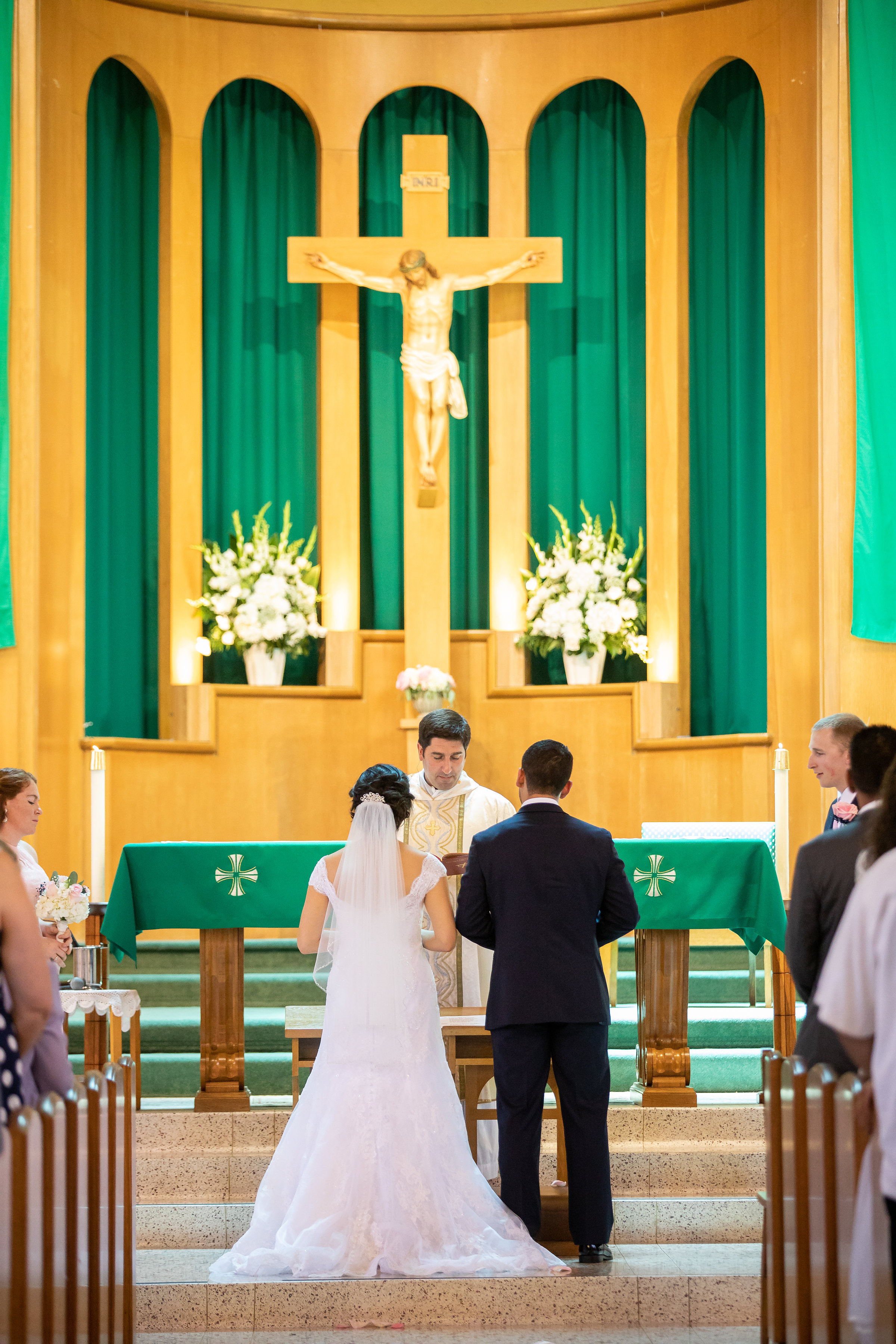 ! Photo of the Bride and Groom in front of the Church alter.jpg