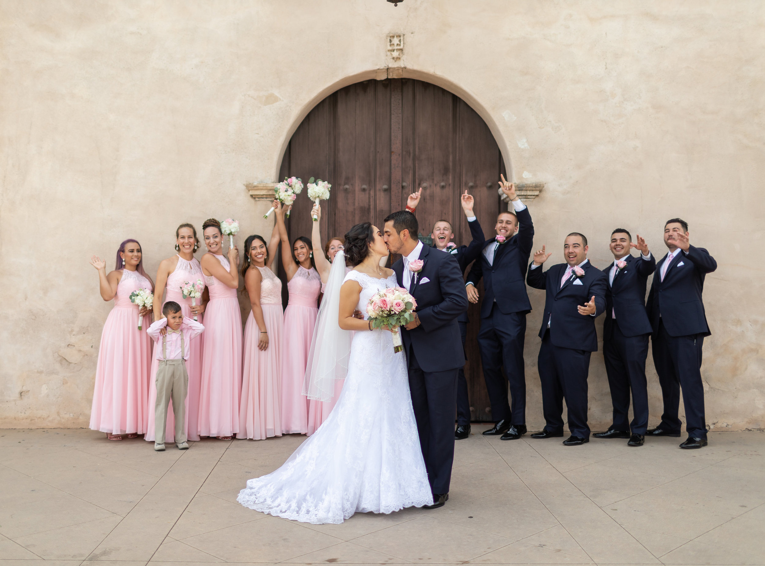 ! Fun Wedding Party Photo with Couple Kissing.jpg