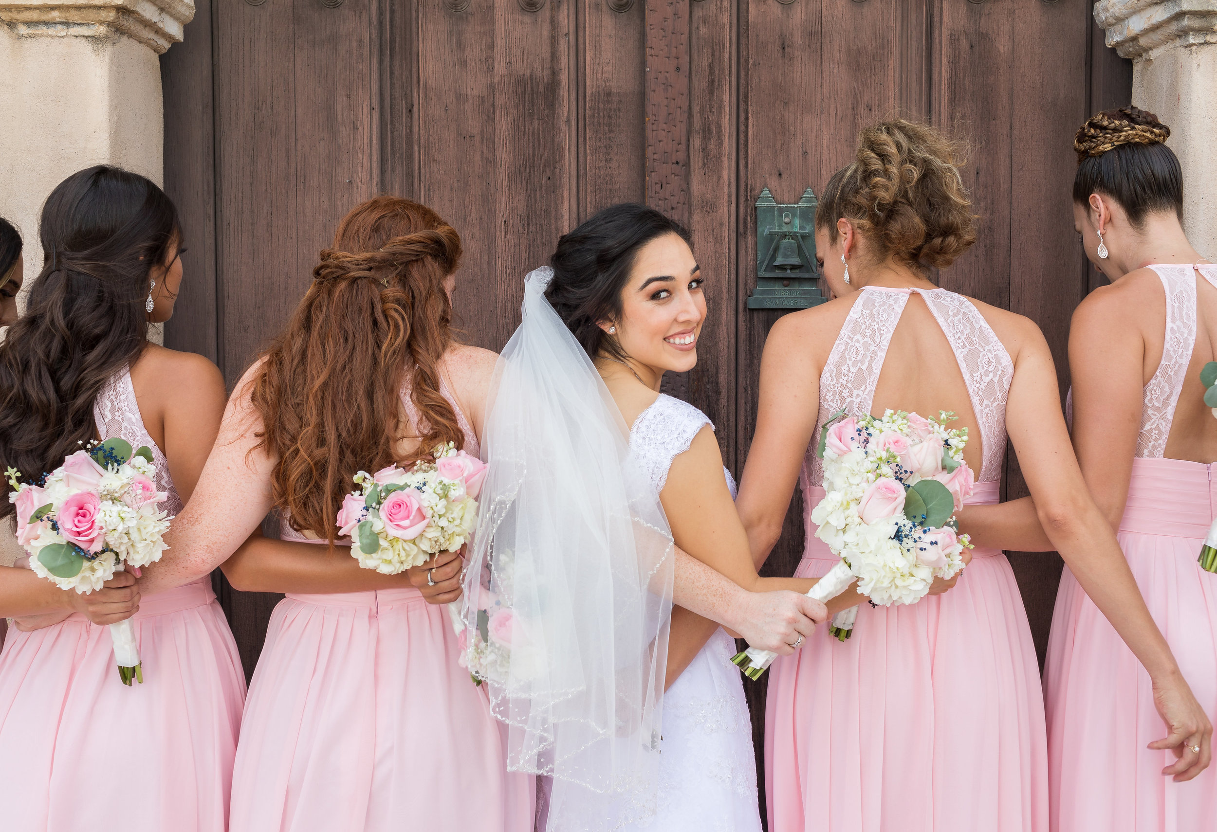! Close up photo of Bride with her Bridesmaids.jpg
