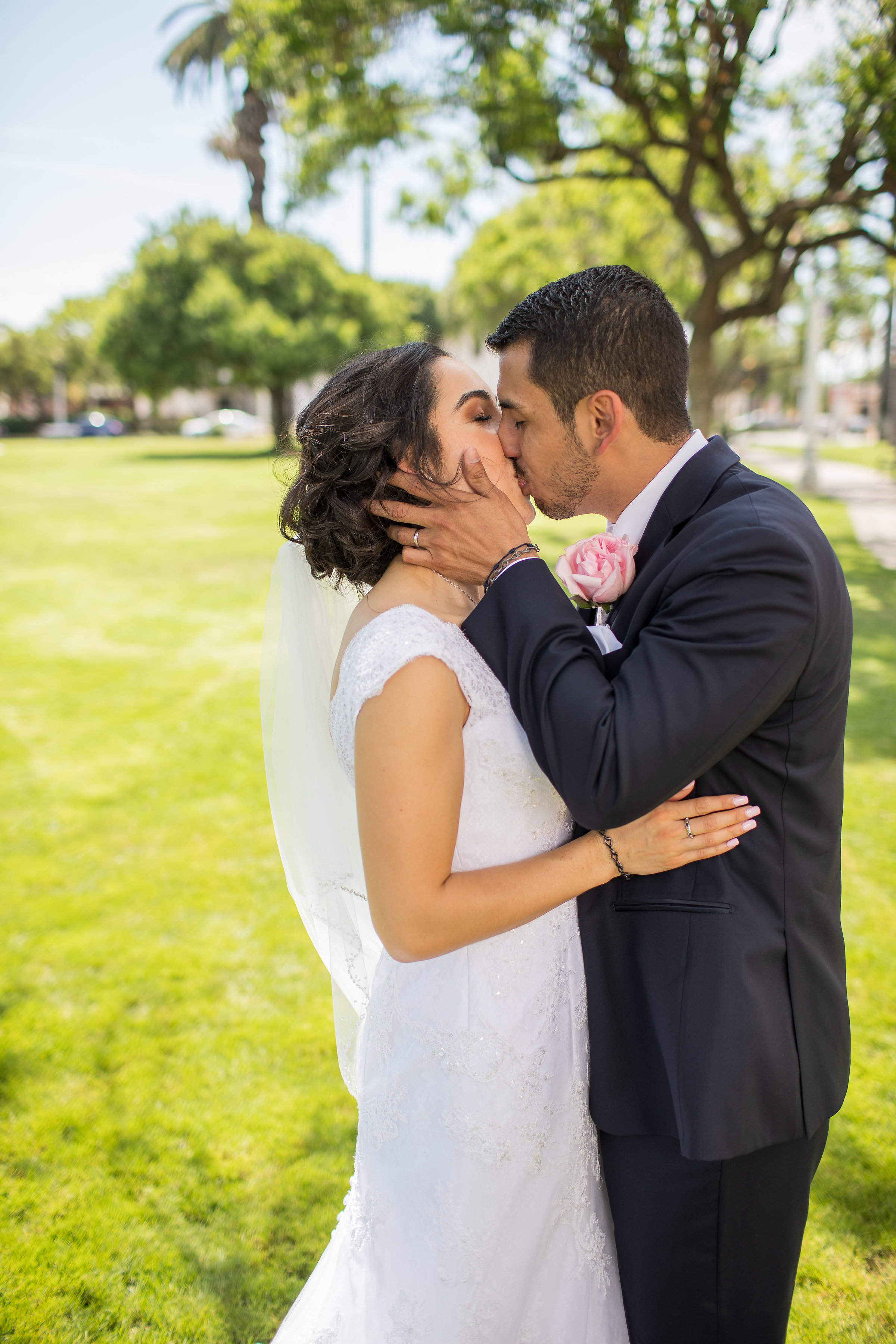 ! Bride and Groom Kissing in the Park.jpg
