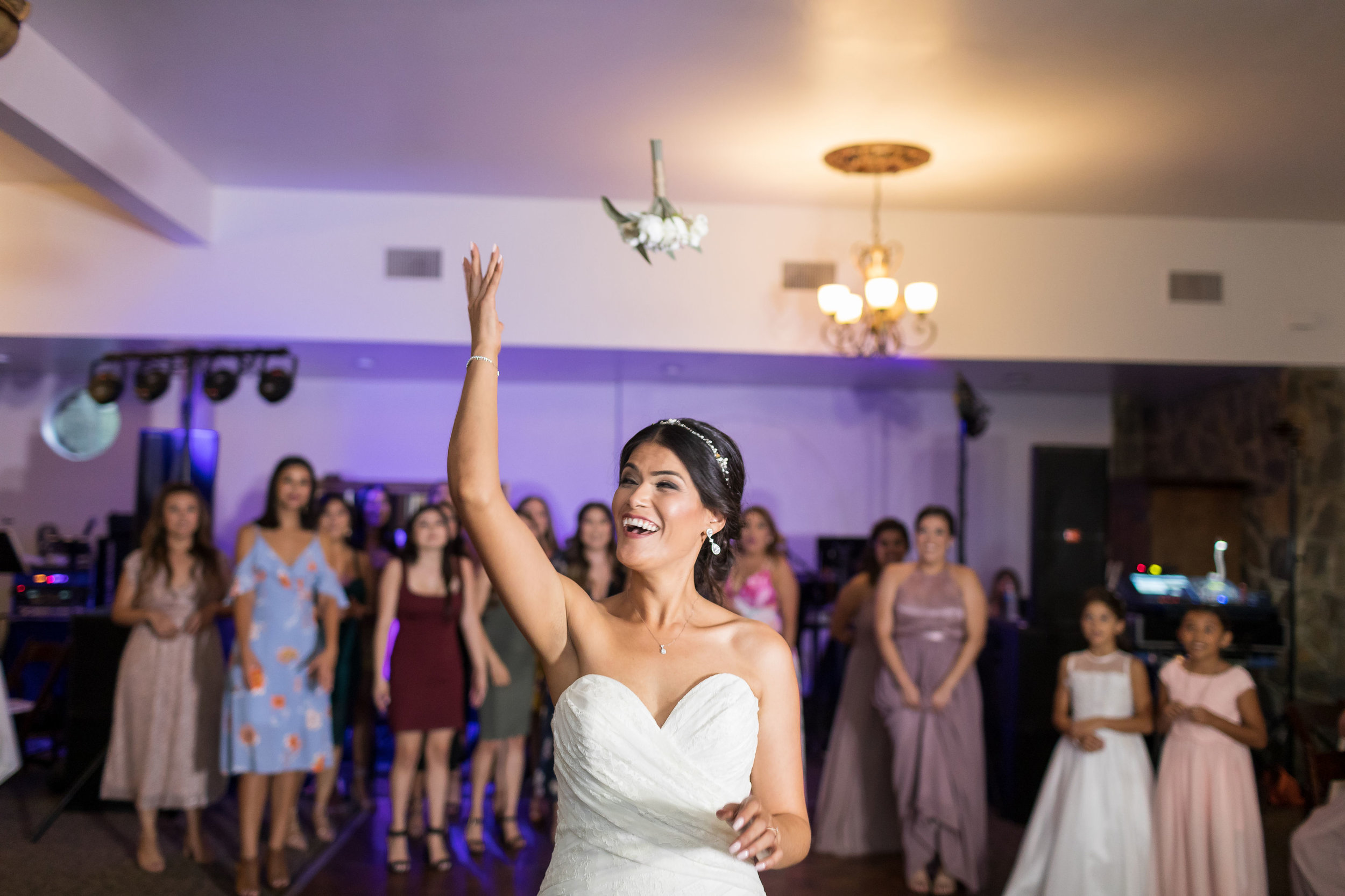 ! Bouquet Toss at Green Parrot Villa.jpg