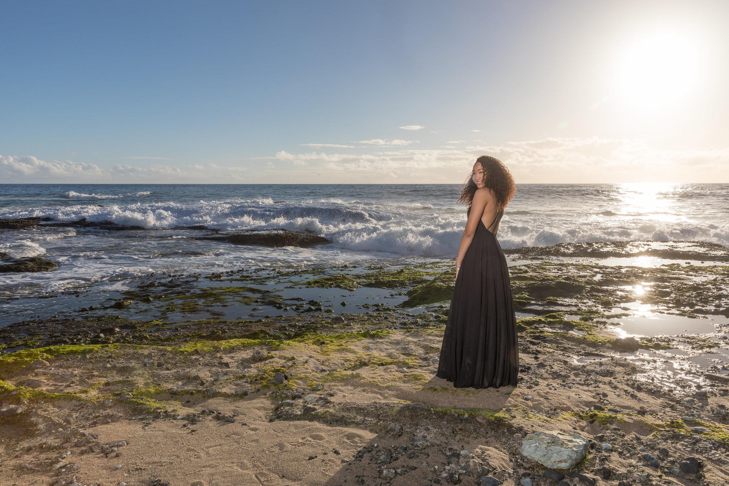 Female Beach Senior Portrait with Sun in background.jpg
