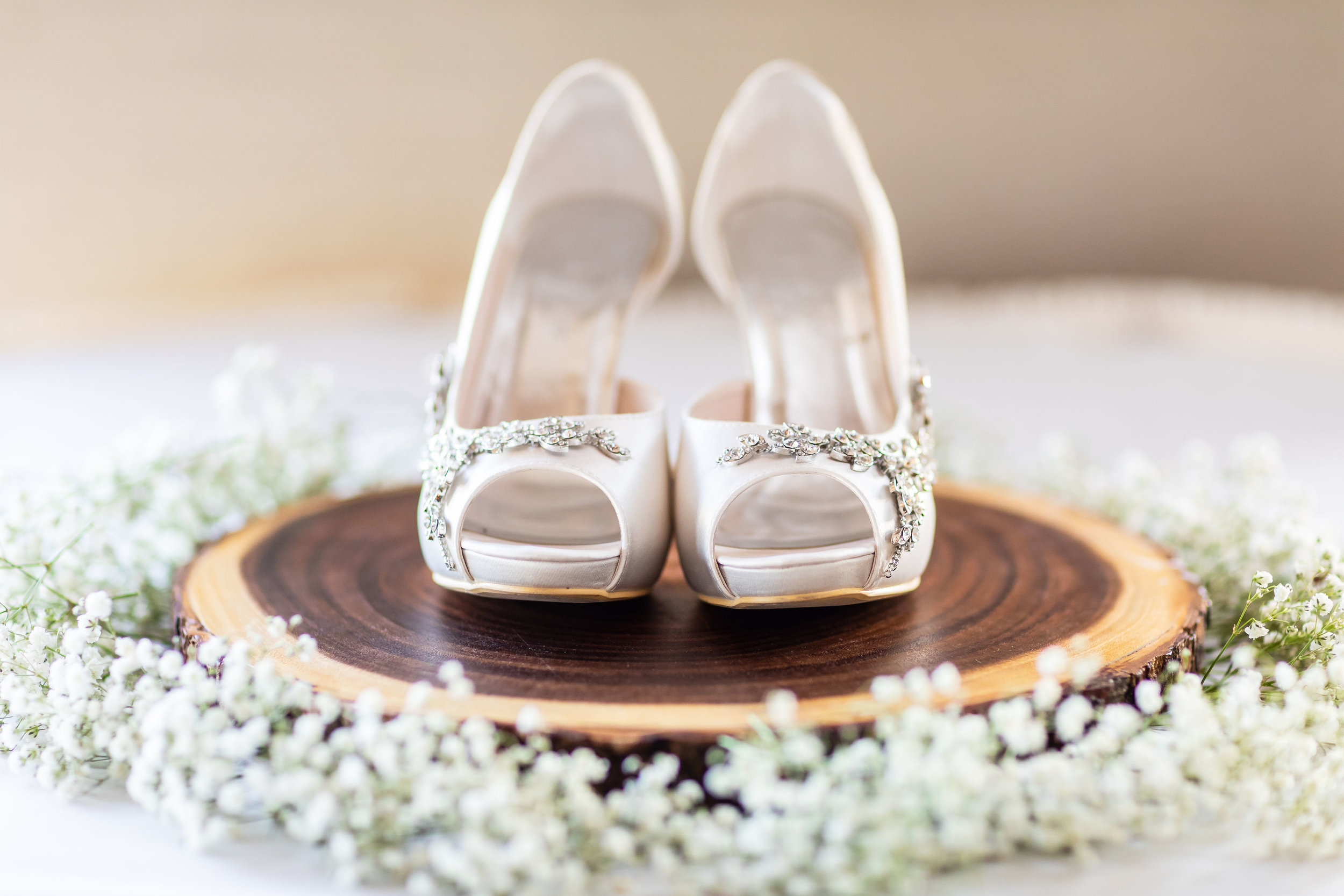 ! Photo of Wedding Heels surrounded by Baby's Breath.jpg