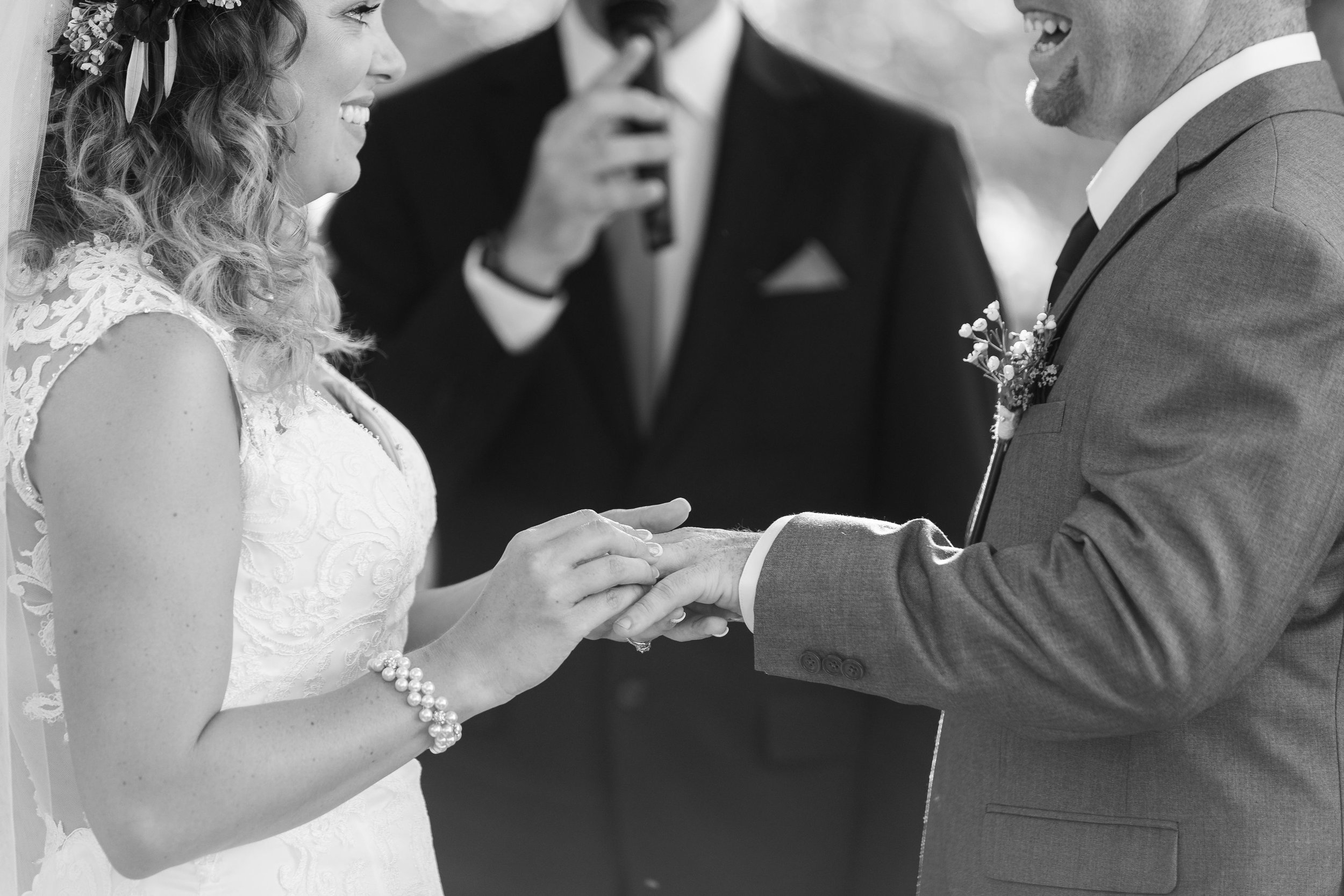 Bride putting ring on Groom at Wedding Ceremony.jpg