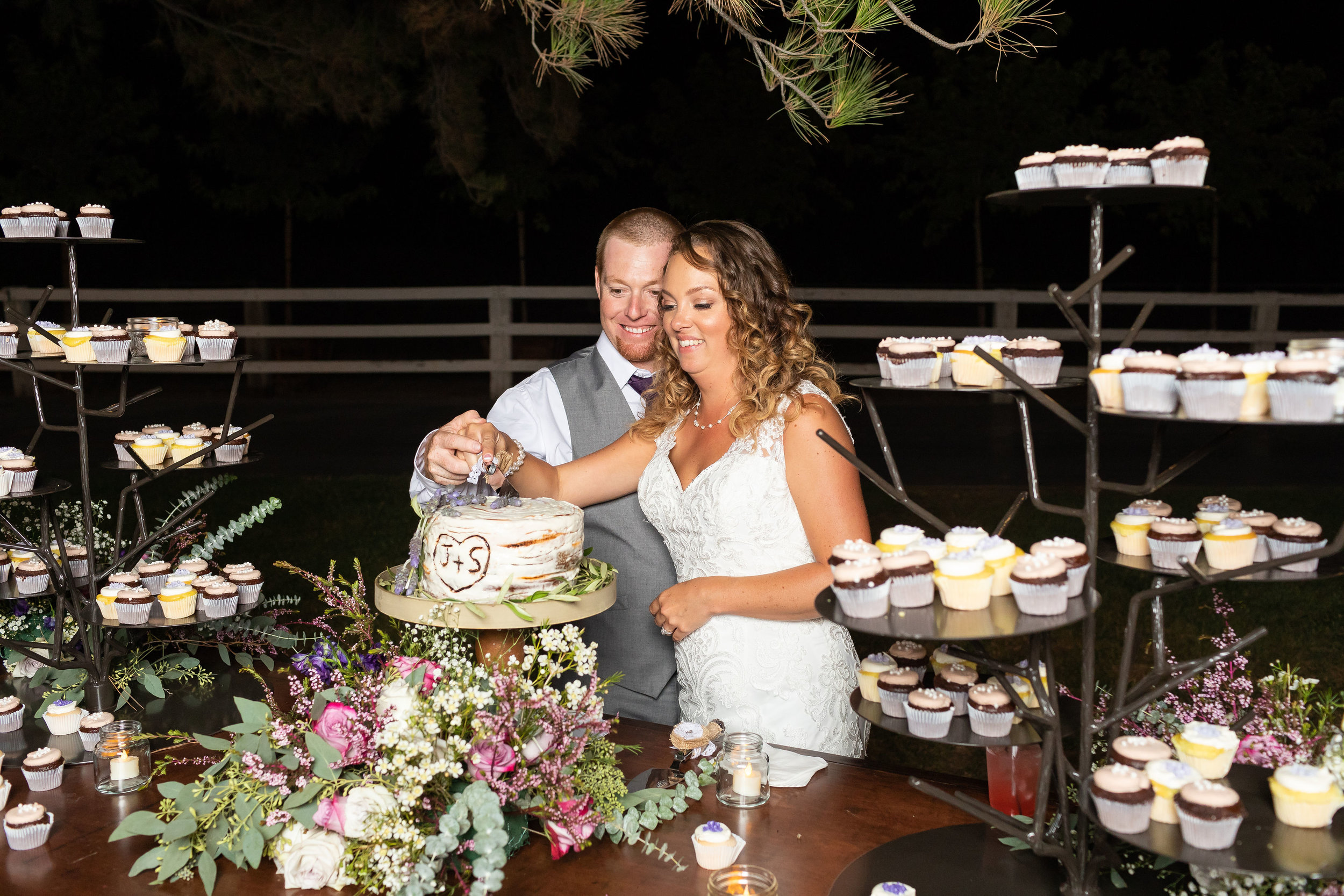 Evening cake cutting outdoor wedding reception.jpg
