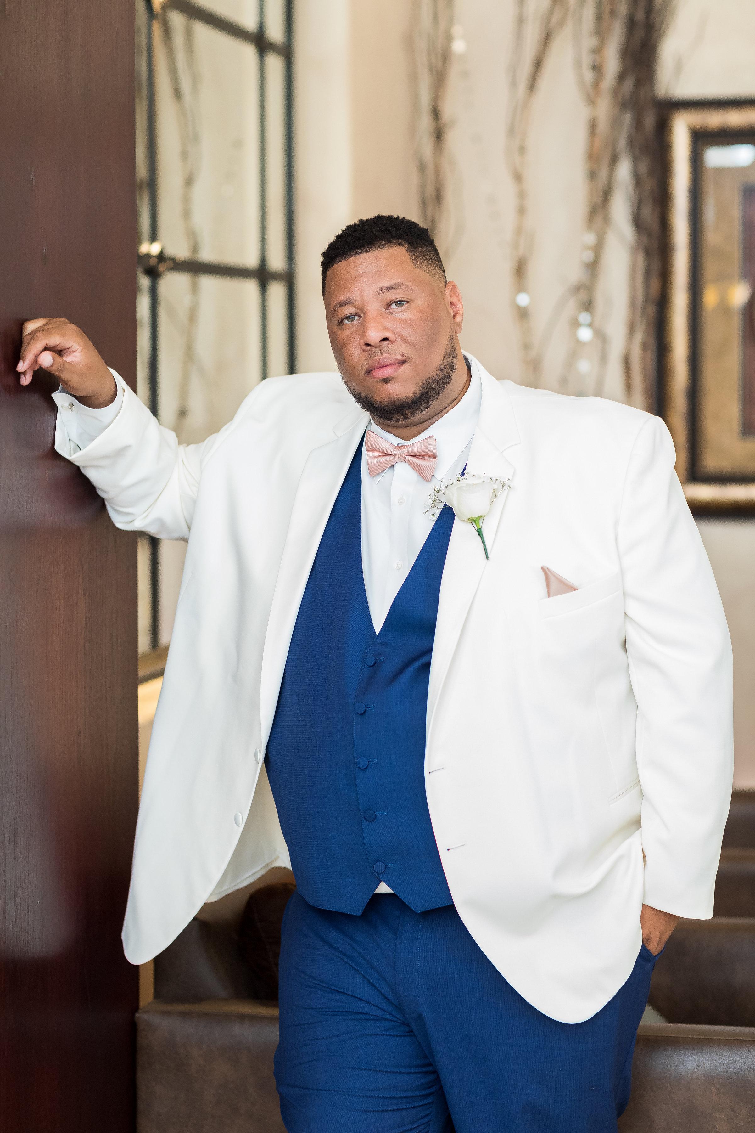 ! Stylish Groom in a White Tuxedo Jacket with a Blue Vest LA Weddings.jpg