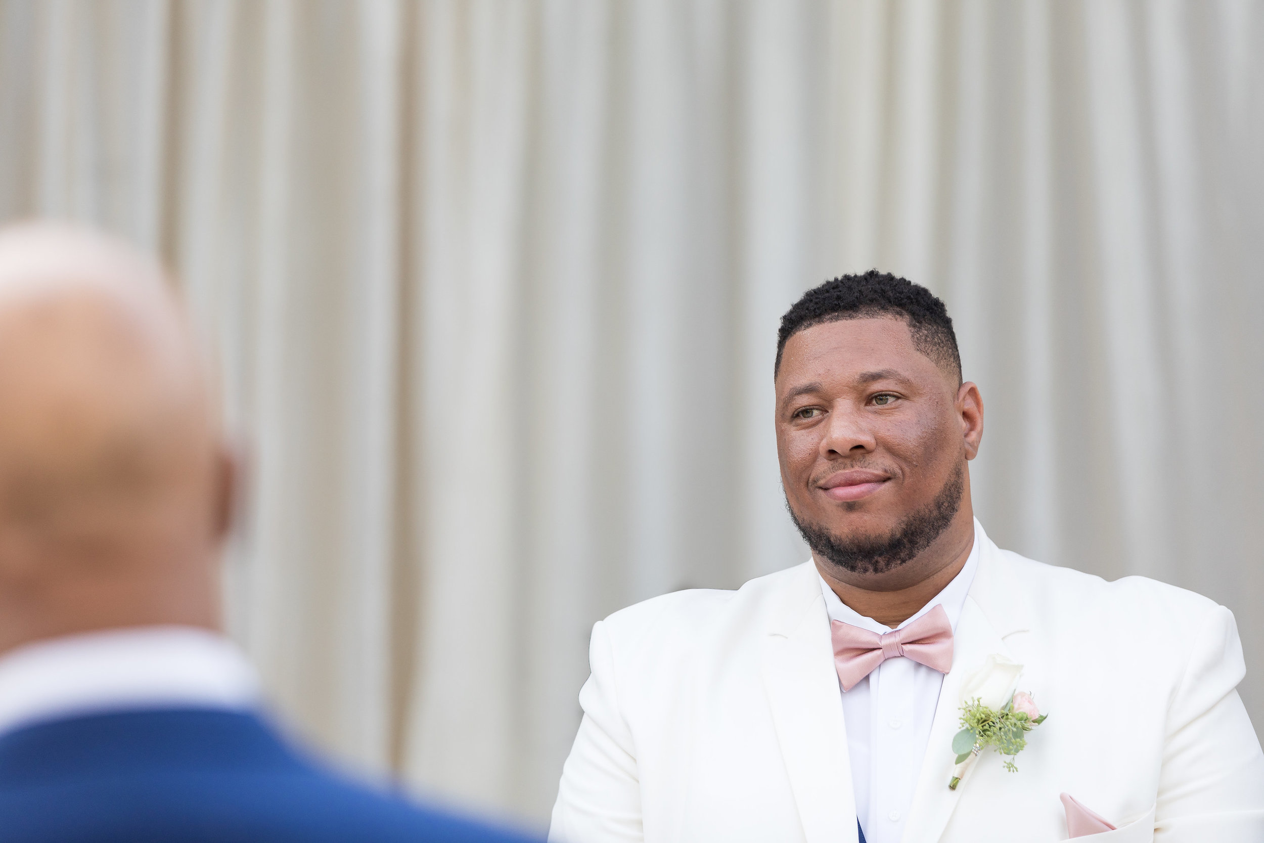 ! Groom's expression as he watches bride walk down the aisle.jpg