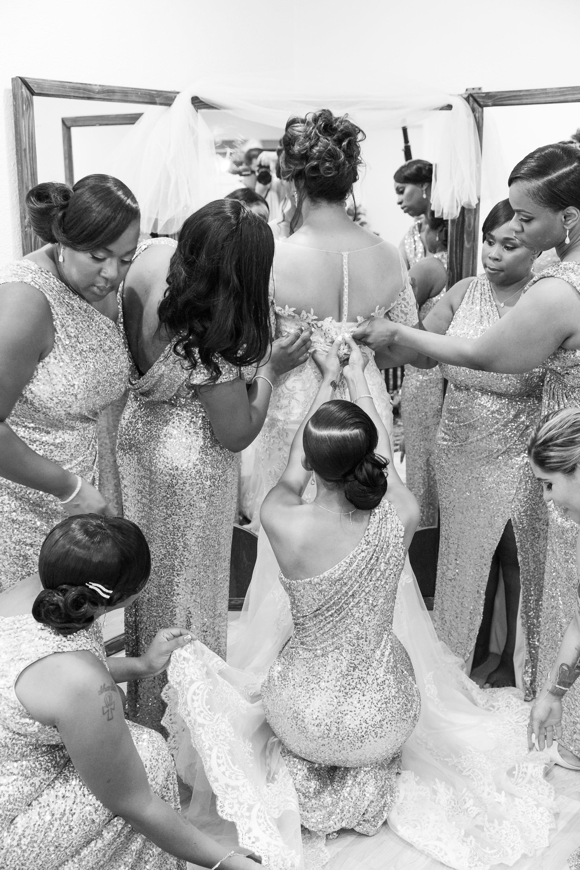 ! Bridesmaids helping Bride into Dress Wedding Getting Ready Photos.jpg