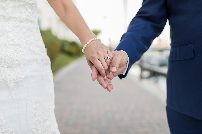 ! Bride and Groom Holding Hands Ring Shot.jpg