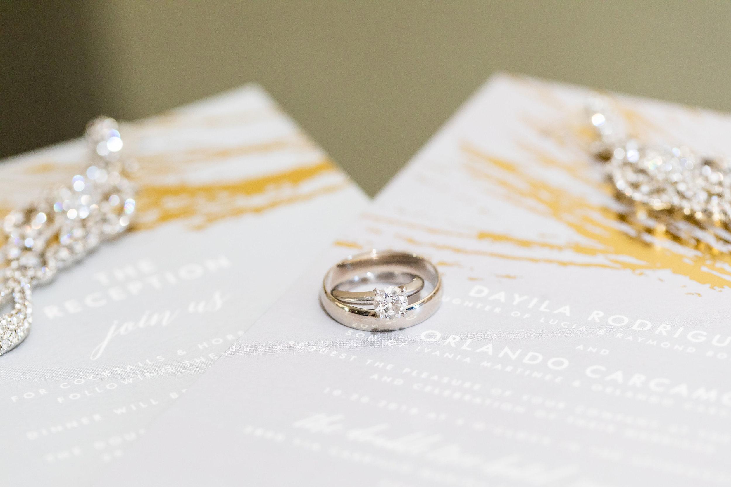! Wedding Rings on Invitation Detail Shots Getting Ready.jpg