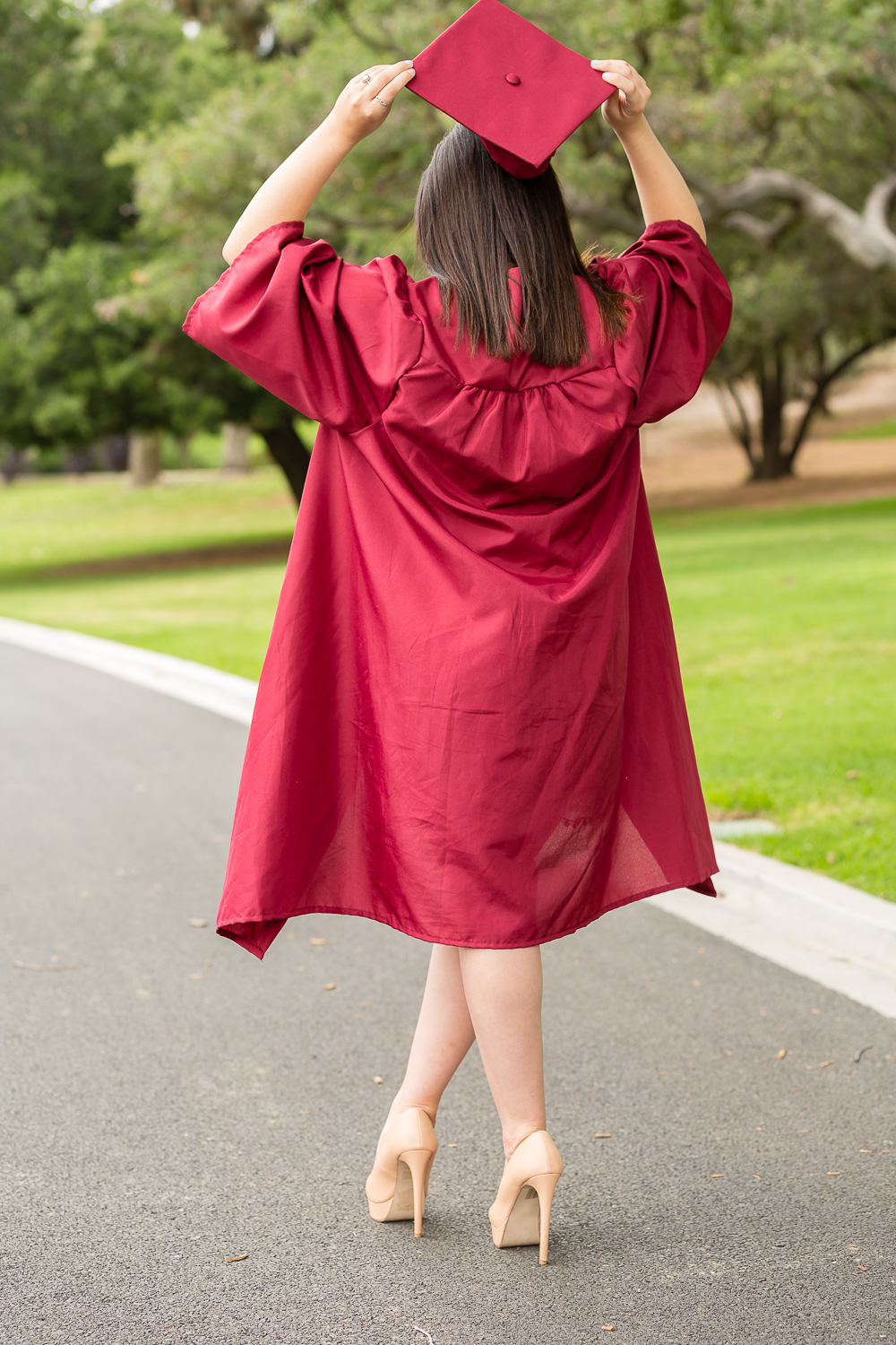 Senior graduate in cap and gown.jpg