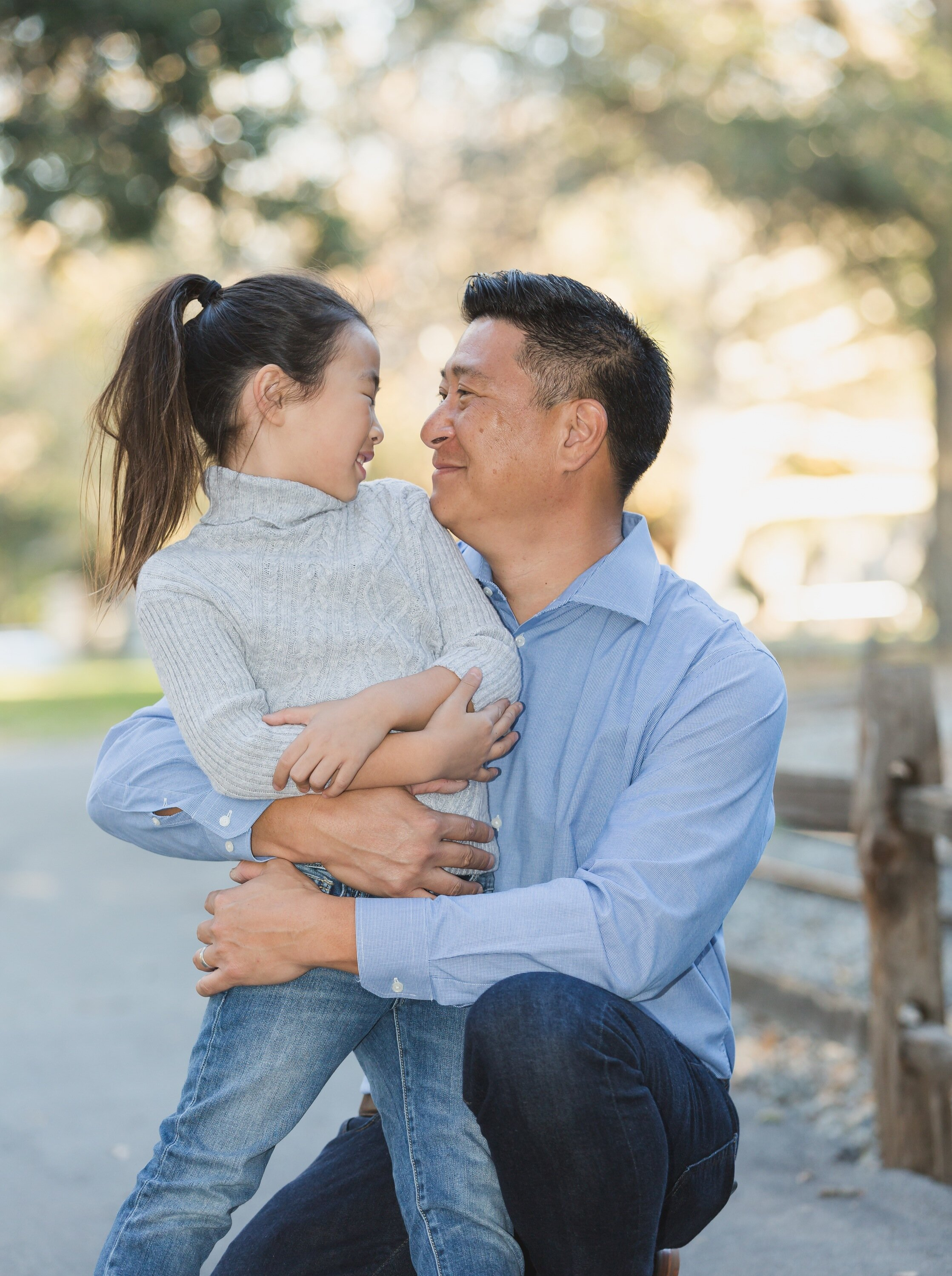 Father Daughter Hugging at Irvine Regional Park Family Photoshoot.jpg