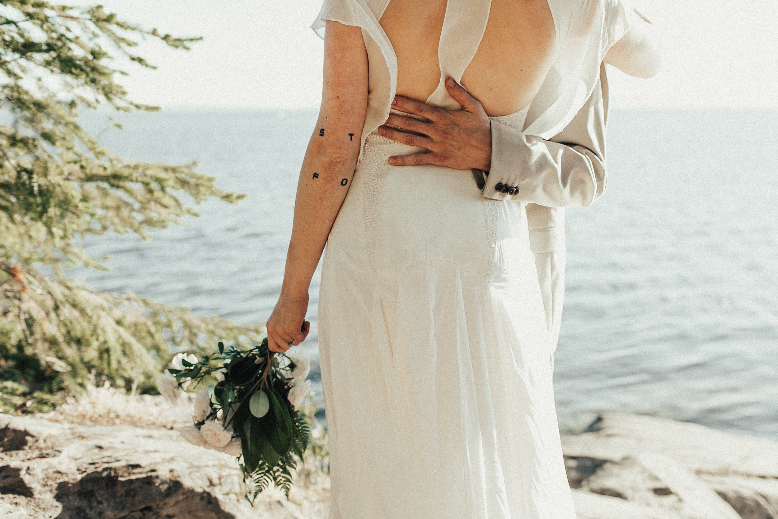 detail of groom's hand on bride's back in Bellingham