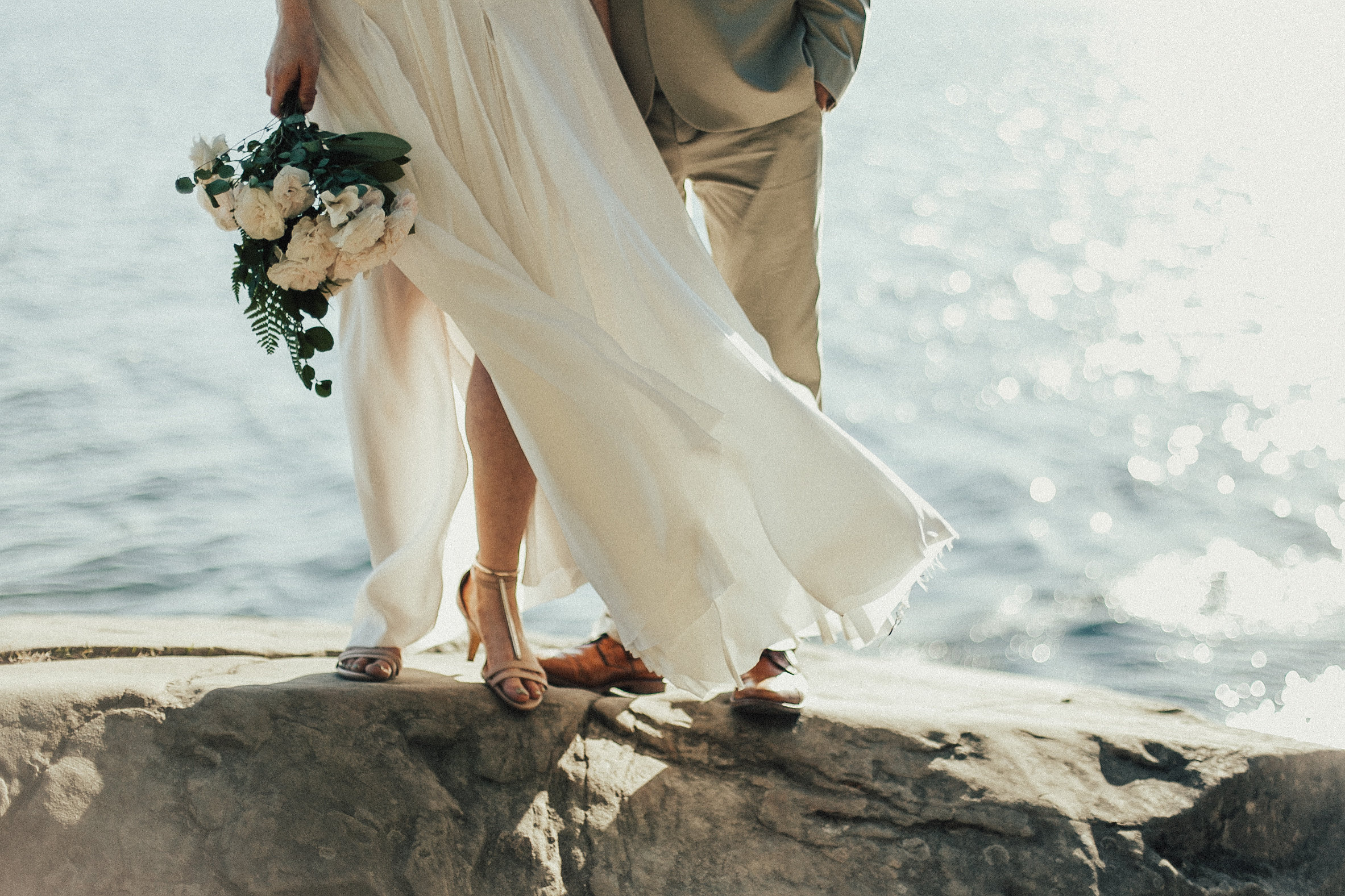 bride and groom stand on the cliffs of Larabee State Park in WA