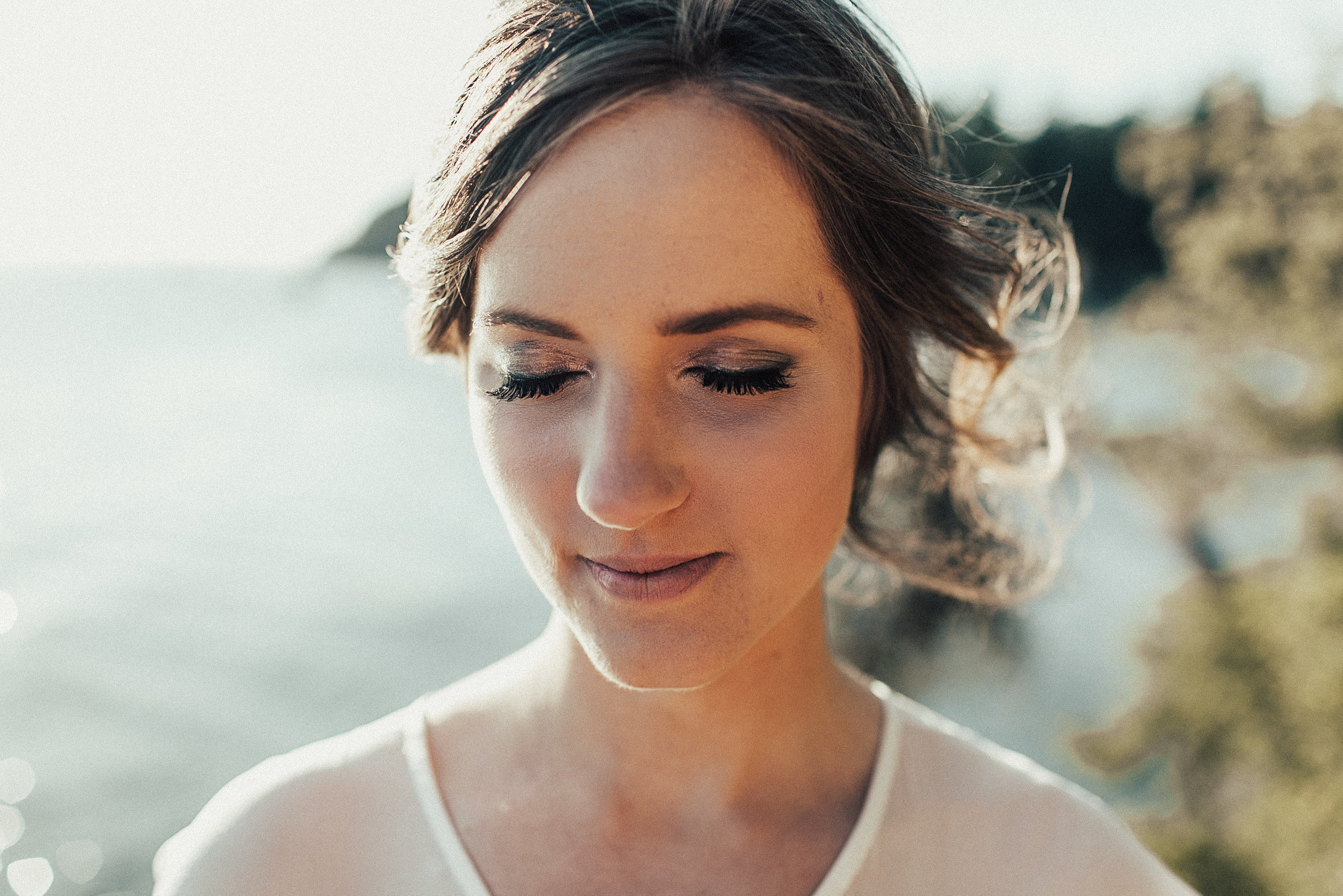 bride with windswept hair on the cliffs at Larabee State Park