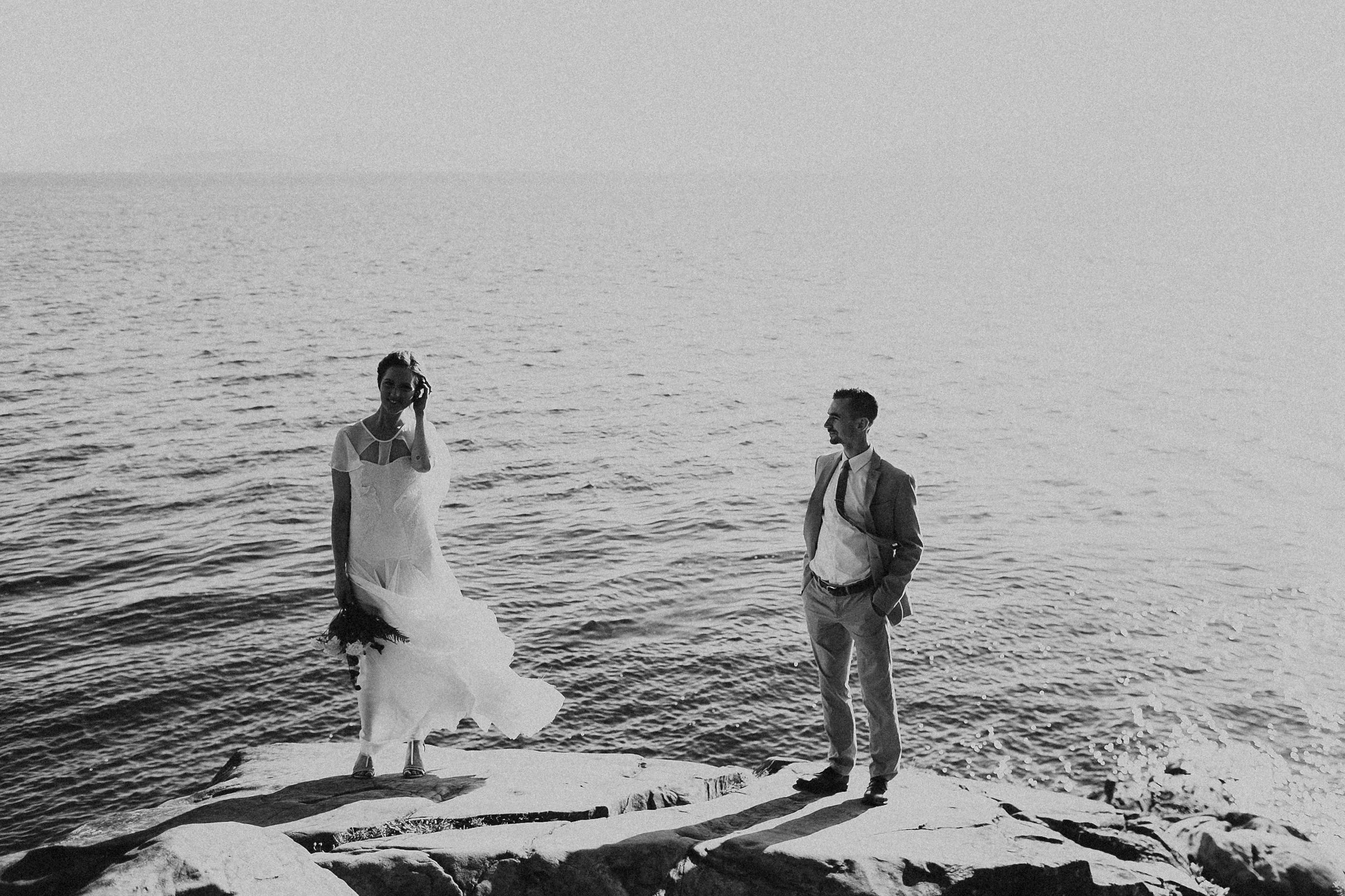 bride and groom standing on the cliffs in Bellingham WA