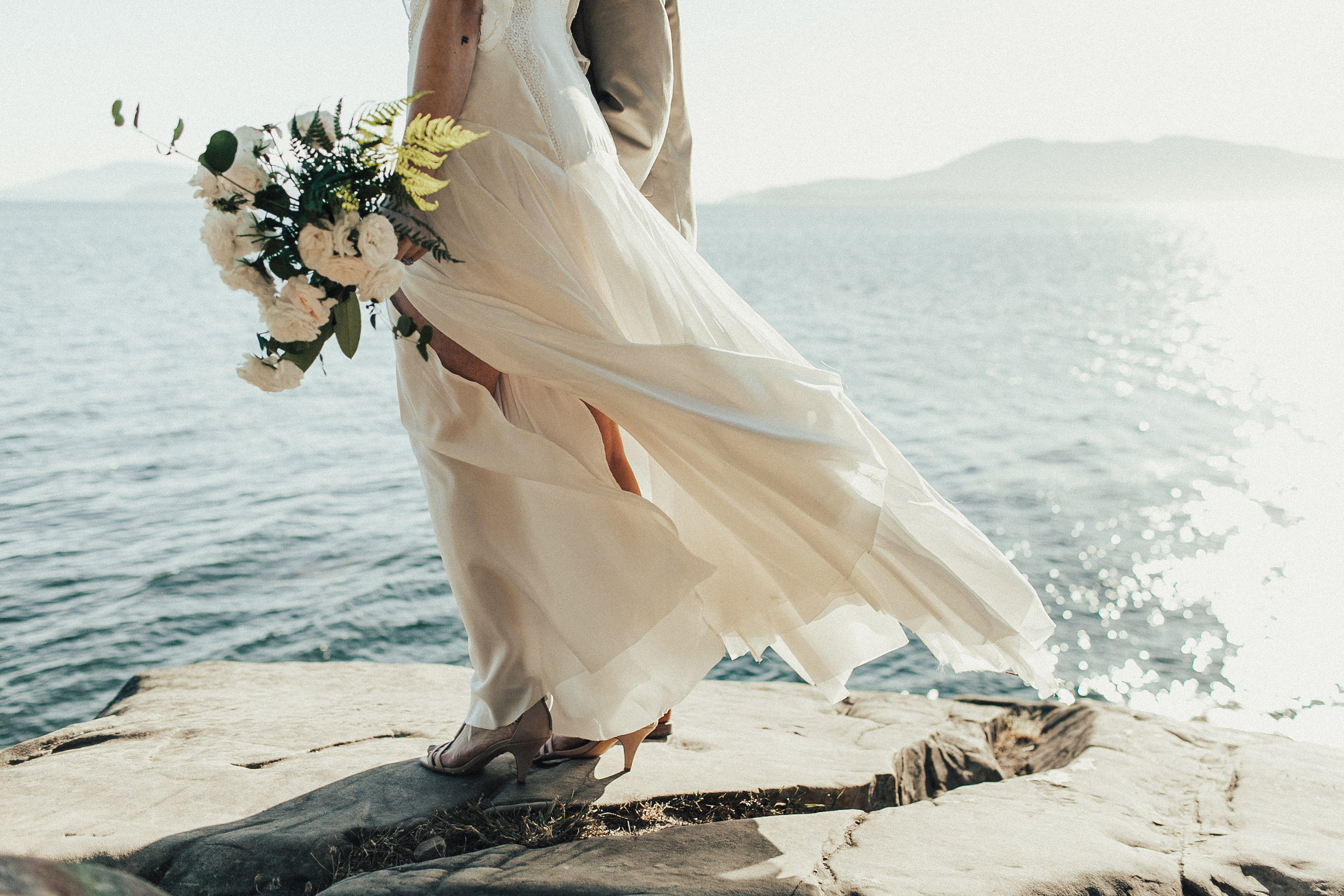 bride with flowing wedding dress on the water in Bellingham Bay