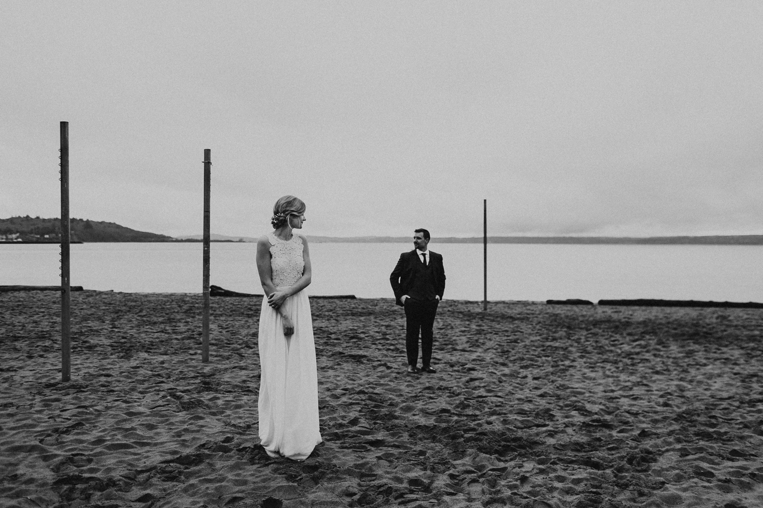 bride and groom on the beach at Golden Gardens in Seattle