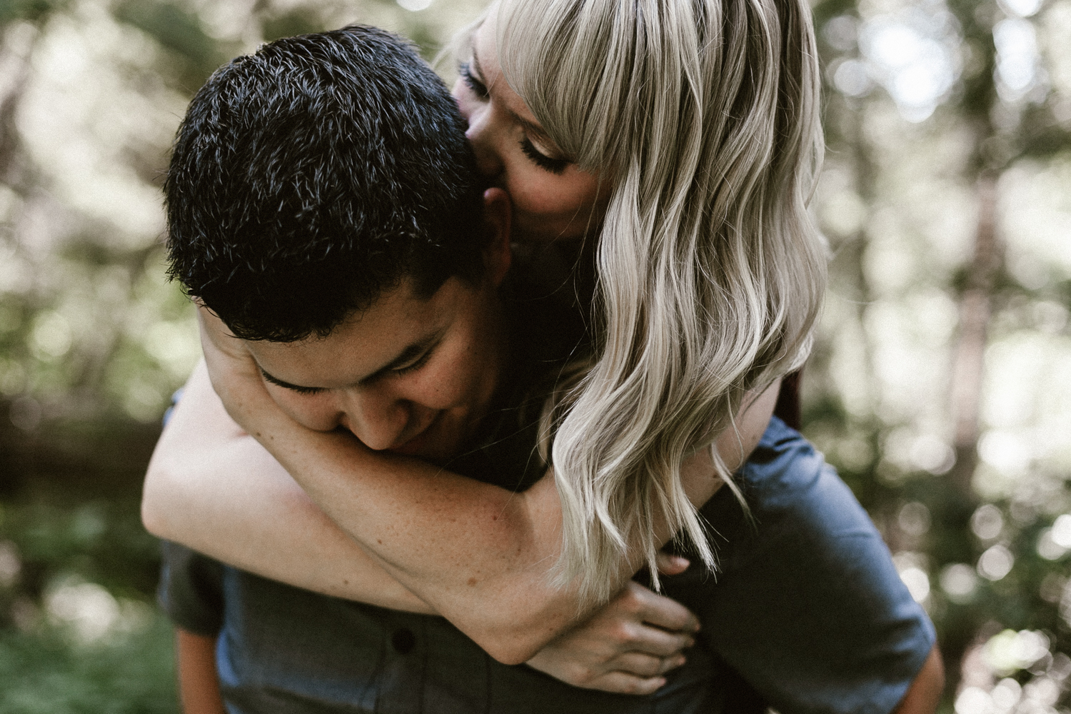 man and woman embrace in the Northwest forest