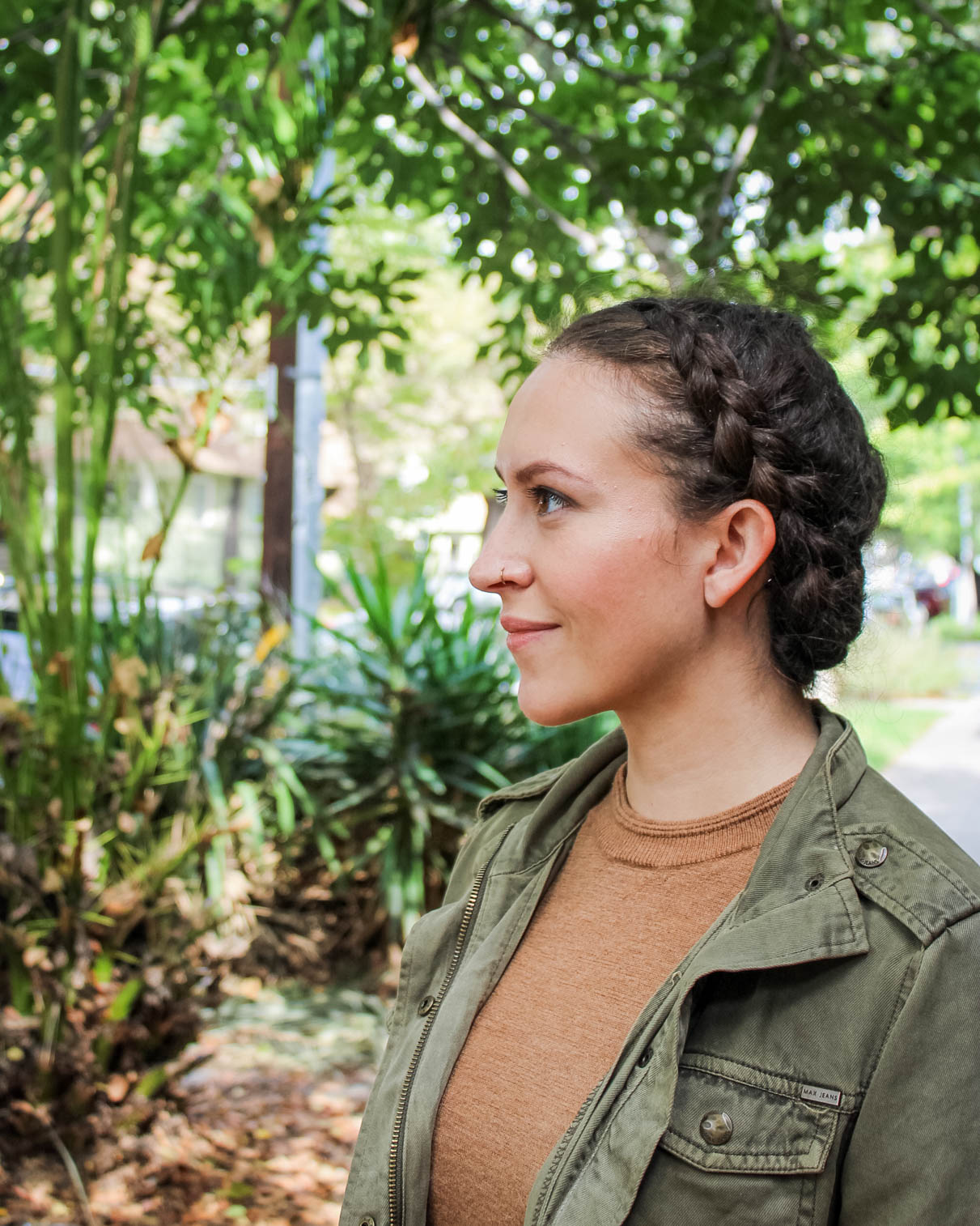 braided naturally curly updo hairstyle for a job interview