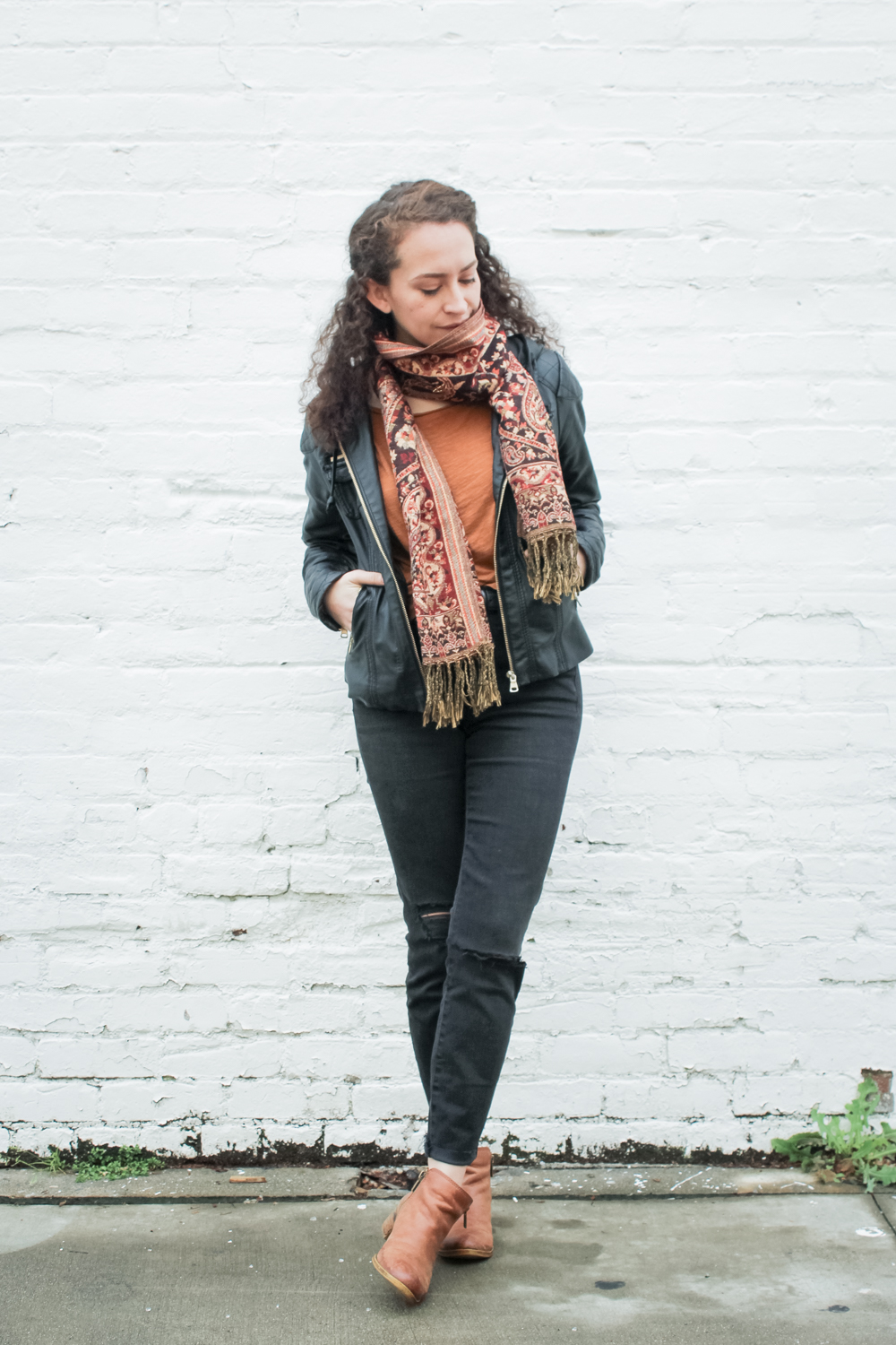 Day 2 of the Spring 10x10 challenge by Lee from Style Bee and Caroline from Unfancy! Here's what I'm wearing. thrifted copper t shirt, high rise madewell jeans, a red and gold blanket scarf, a leather jacket and lucky brand basel ankle boots | tinted-green