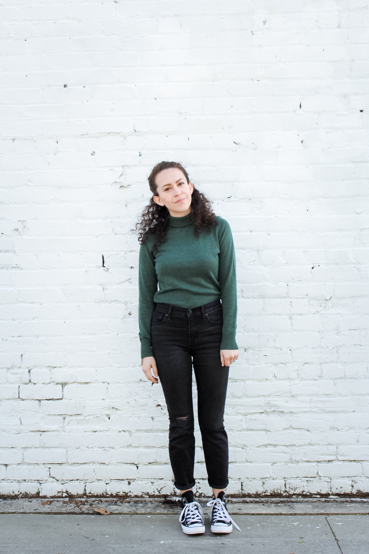 wearing my moss green turtleneck sweater with high rise madewell jeans and high top converse for day 7 of the spring 10x10 & unfancy remix challenge. the pieces all come from my spring capsule wardrobe | tintedgreen