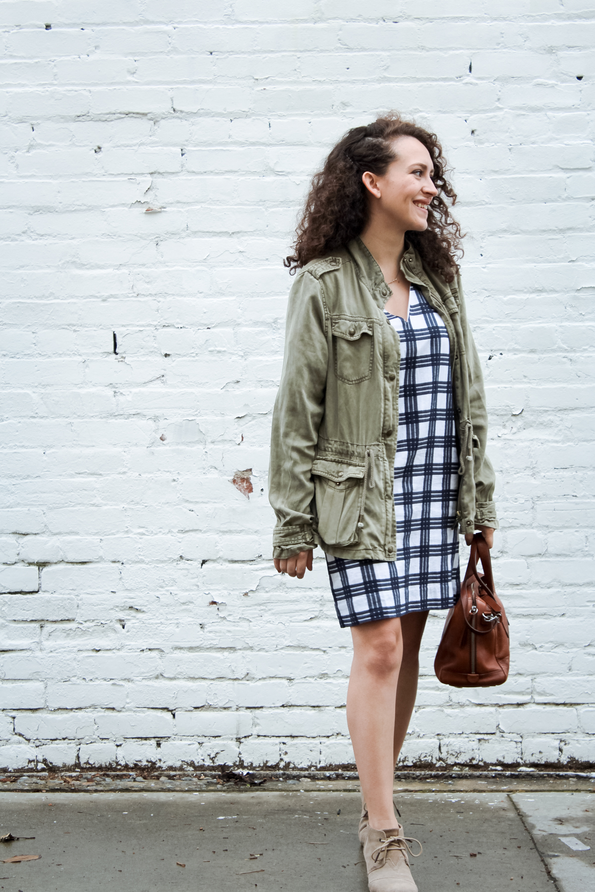 my look for day 10 of the spring 10x10/unfancy remix challenge is a rule breaker. a bell sleeve windowpane shift dress from madewell paired with a light olive green jacket, suede wedge heels from TOMS and a leather satchel bag from Fossil | tintedgreen