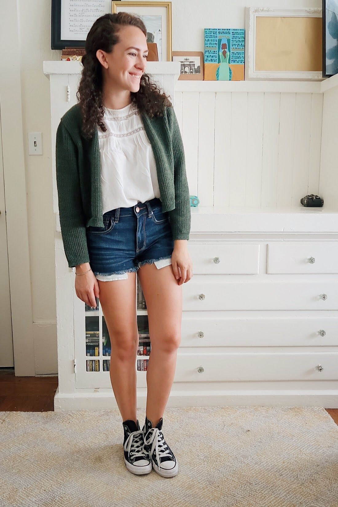 my mid-season mini haul included these dark wash high rise denim shorts from american eagle. so comfy and so easy to wear. styled with a white flowy blouse, black high top converse, and my thrifted olive green cropped cardigan. kinda perfect for back to school.