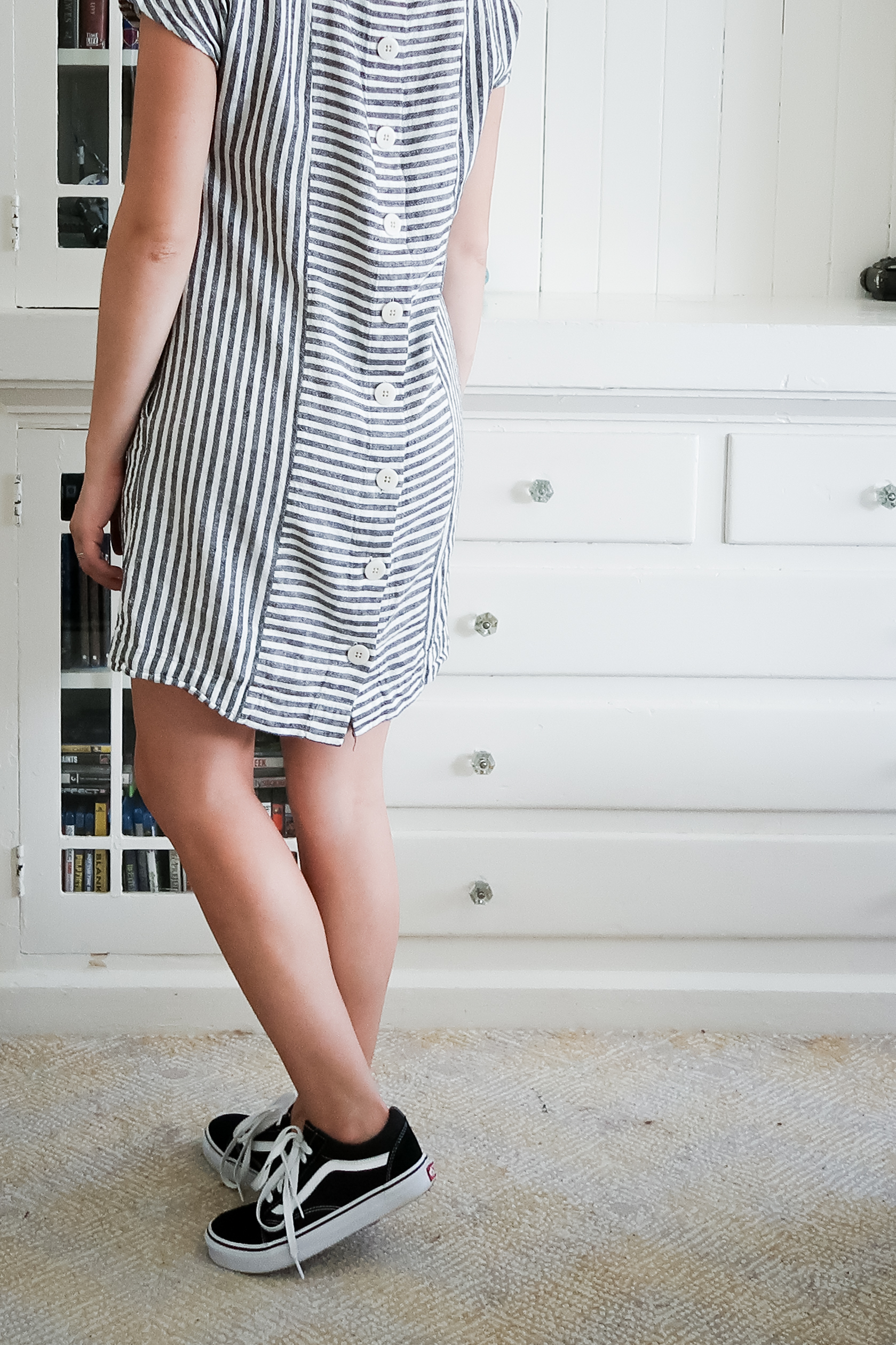 10 pieces, 10 outfits -- i didn't really need new sneakers when i bought these vans but i've been wearing these non stop since i got them. they of course look great with casual outfits but i even love them paired with dresses like this striped button back linen shift dress from madewell