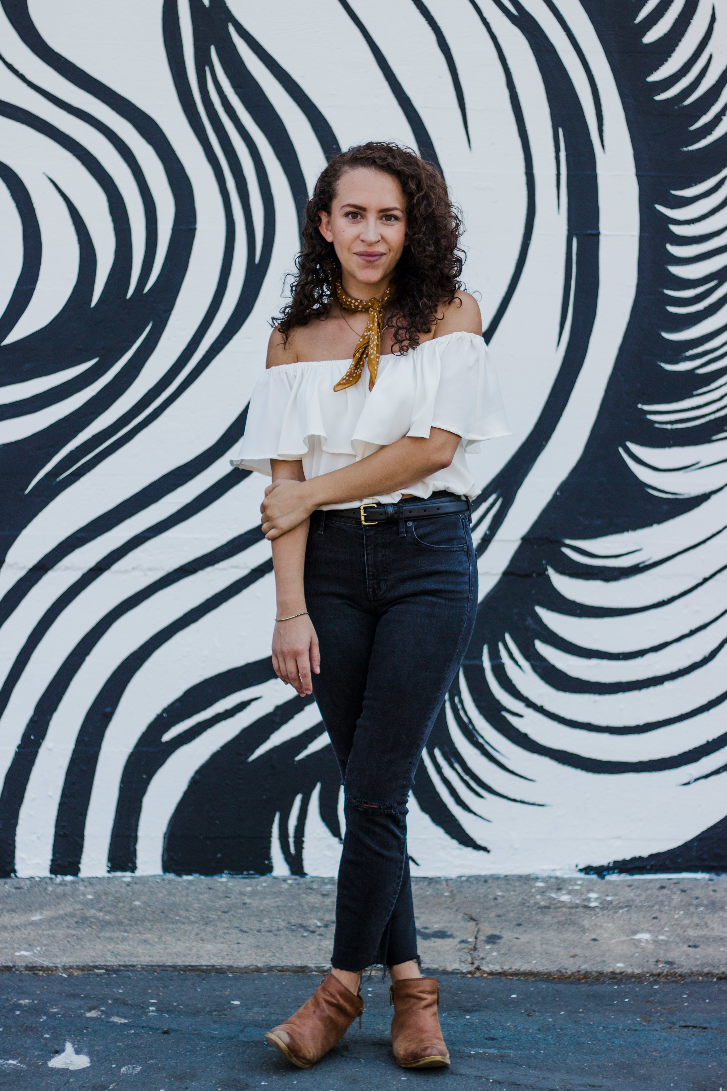 casual date night outfit -- black high rise skinny jeans (from madewell) worn with a white ruffled off the shoulder top, ankle boots and a bandana around the neck