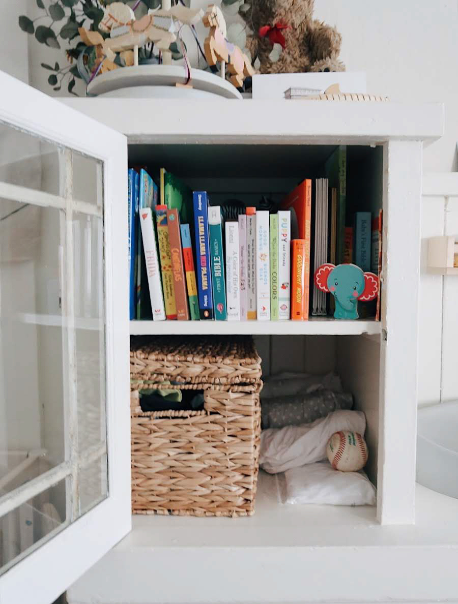 tinted-green.com | minimalist nursery, nursery nook, baby in a studio, bilingual books, gender neutral nursery, small space nursery, earth tone nursery
