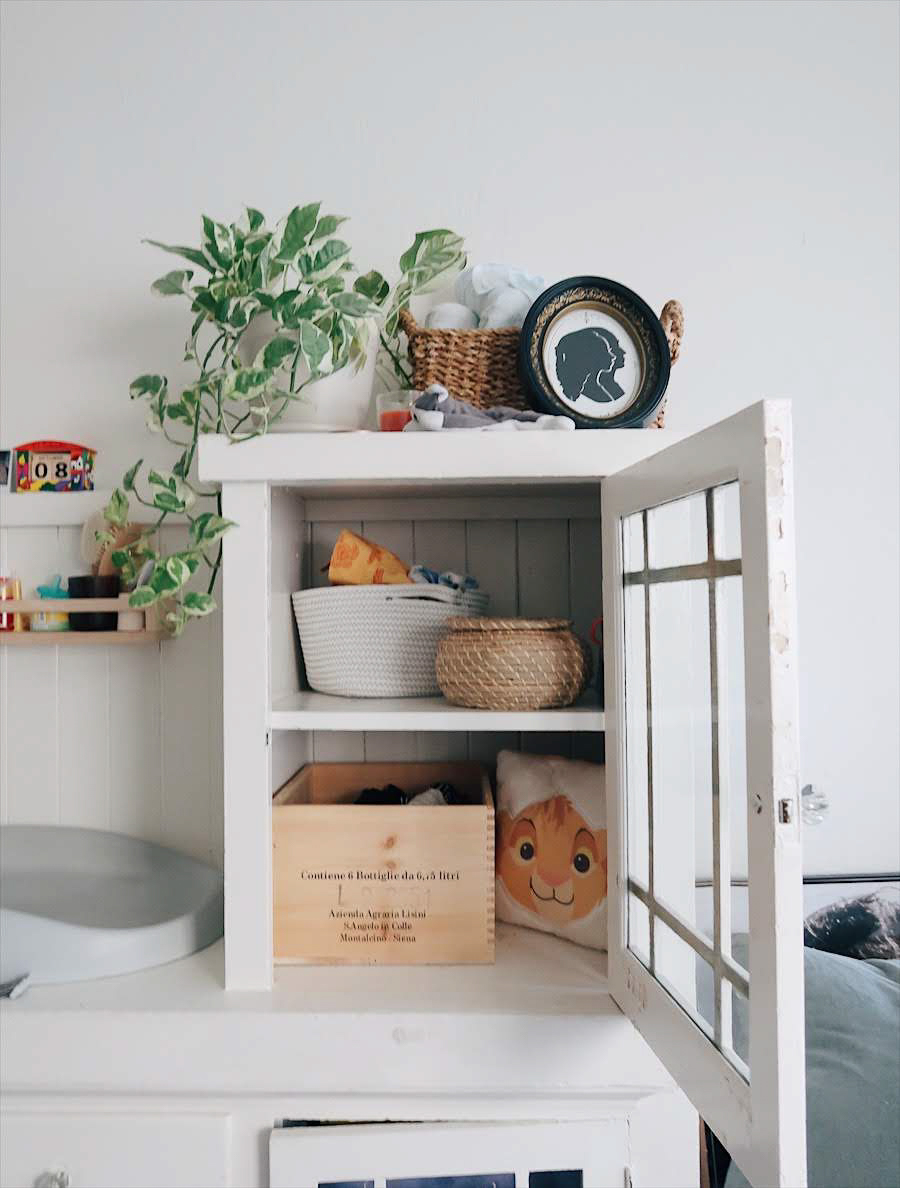 tinted-green.com | minimalist nursery, nursery nook, baby in a studio, gender neutral nursery, small space nursery, earth tone nursery