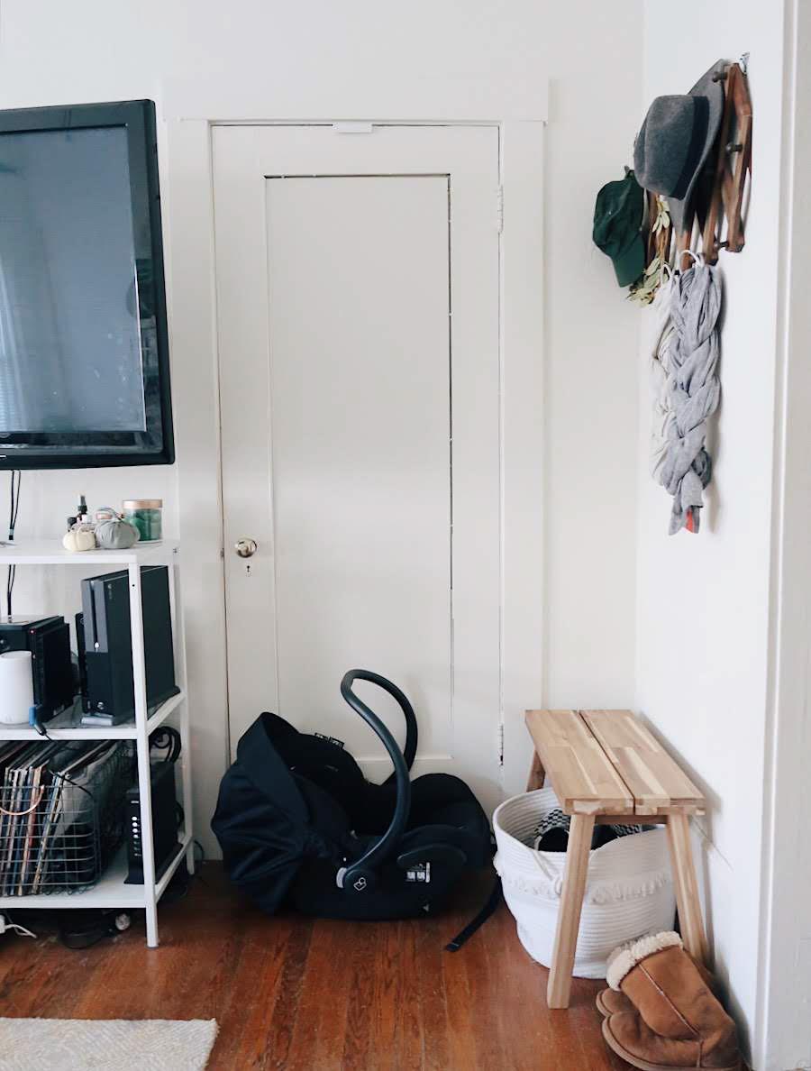 tinted-green.com | minimalist nursery, nursery nook, baby in a studio, gender neutral nursery, small space nursery, earth tone nursery, maxi cosi infant car seat