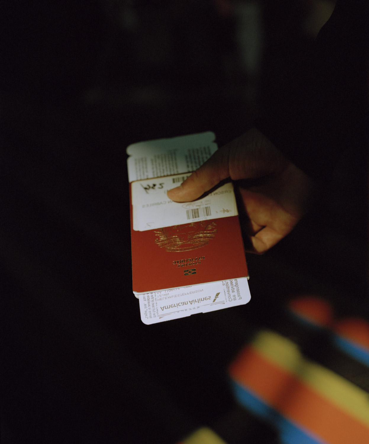 2. Estefferson holding passport at the airport before leaving_.jpg