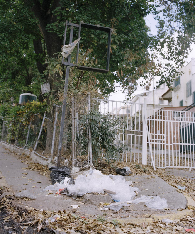 21. Street corner in Caracas filled with opened trash.jpg