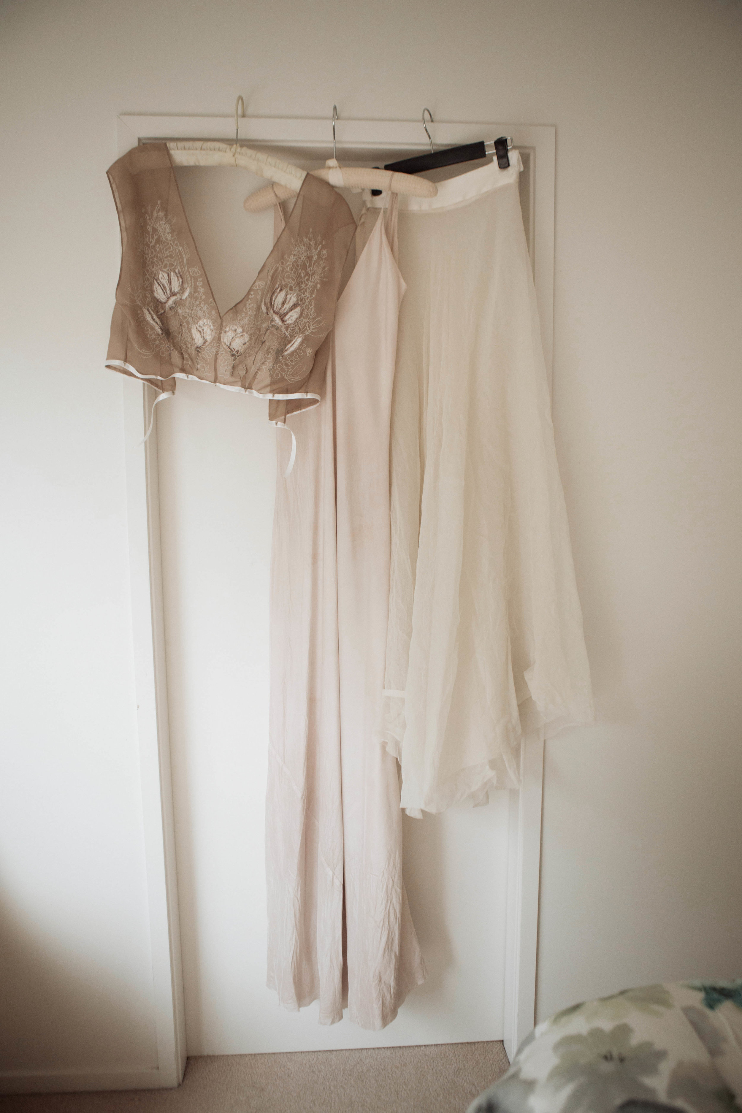 The combo - the silk chiffon top is designed to hook inside the ribbon of the skirt and tack onto the silk slip, making it removable during the event.