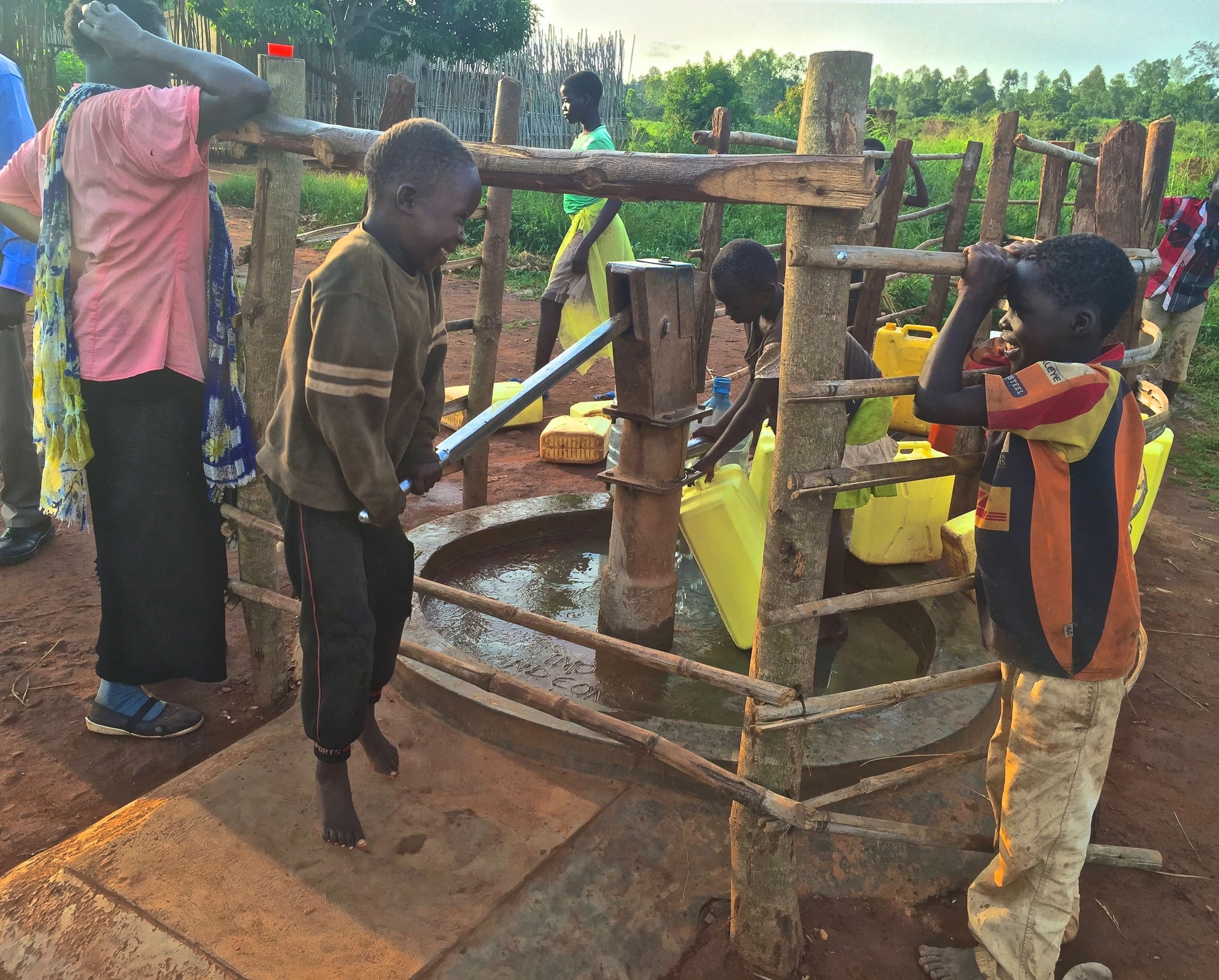 Children in Gulu celebrate Water & Health For All's rehabilitation of the borehole well  Wang Ojara  in 2015.