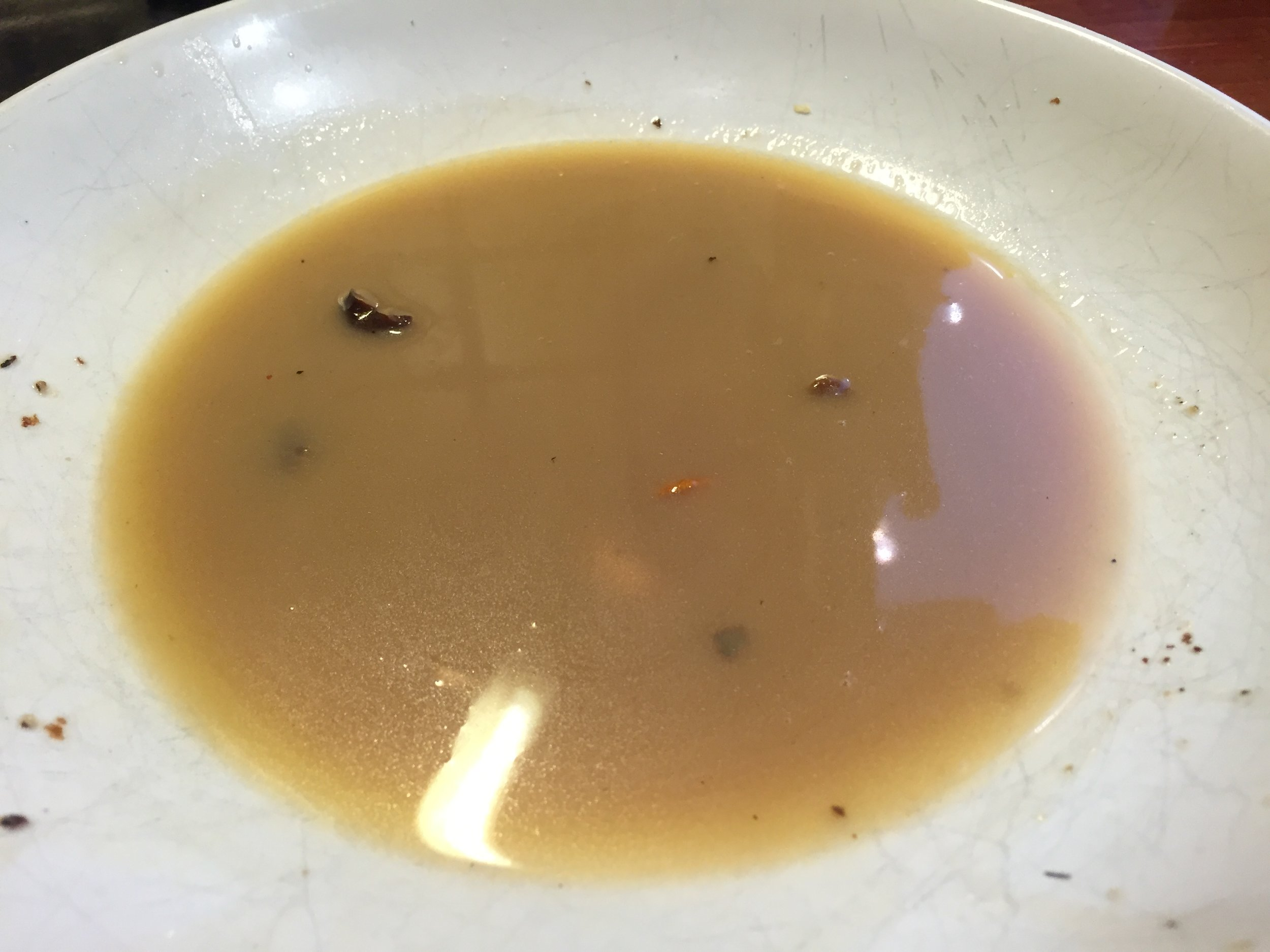 The butter and mushroom stock, drained from the pan after frying for approximately 3 minutes on a high heat