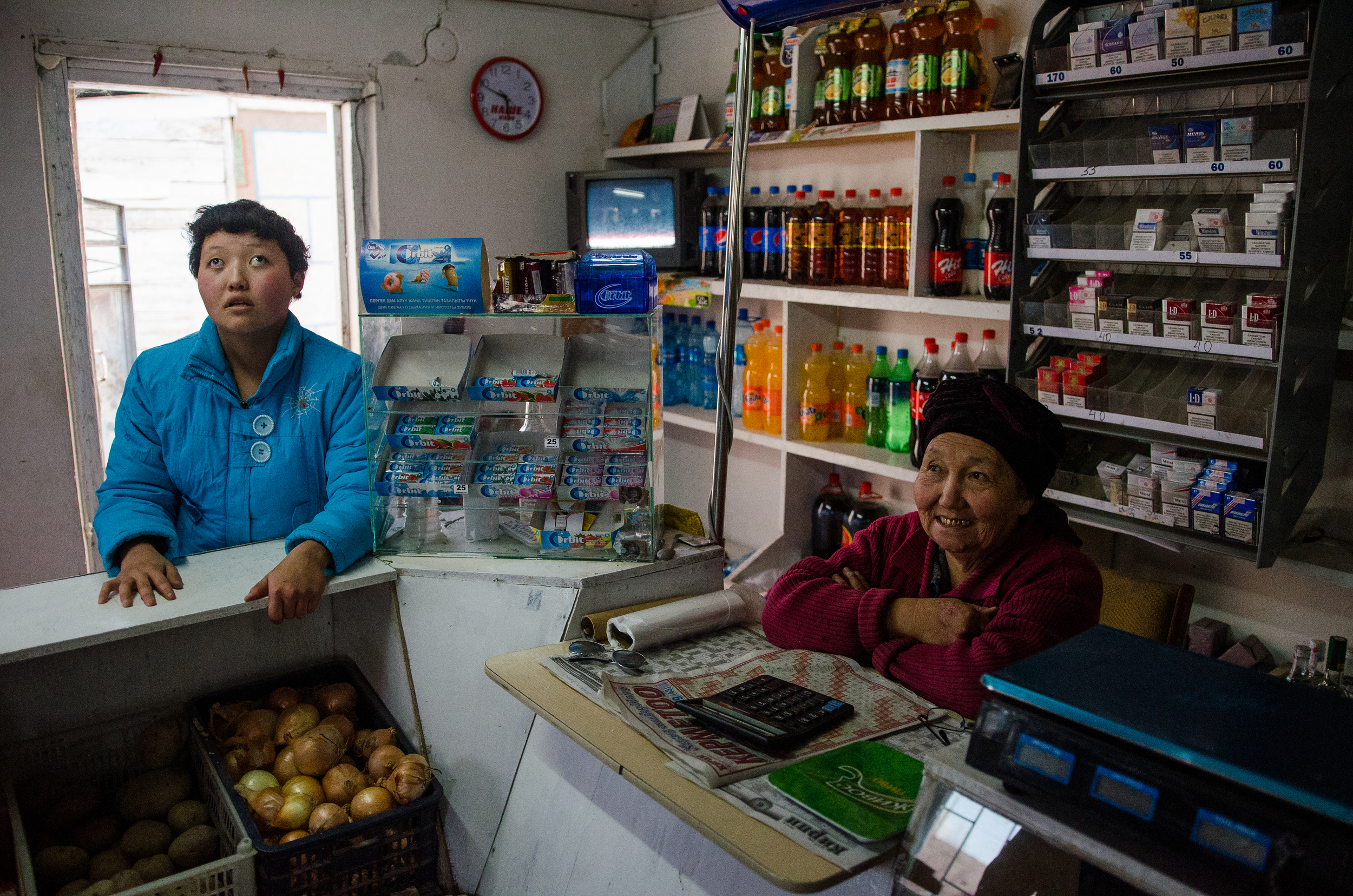 Adinai and her grandmother in their little corner shop.