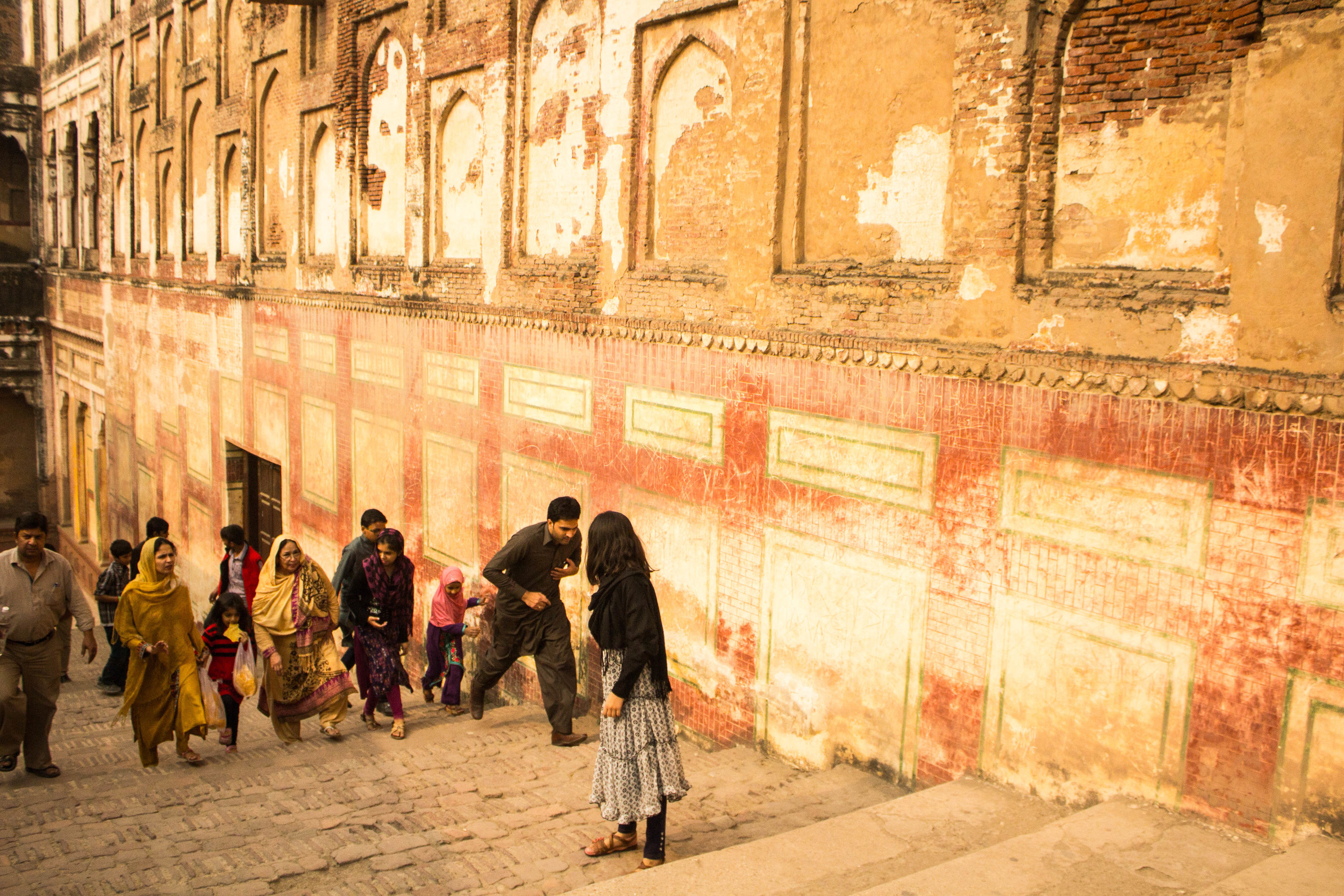 Families move between levels of the Lahore fort.