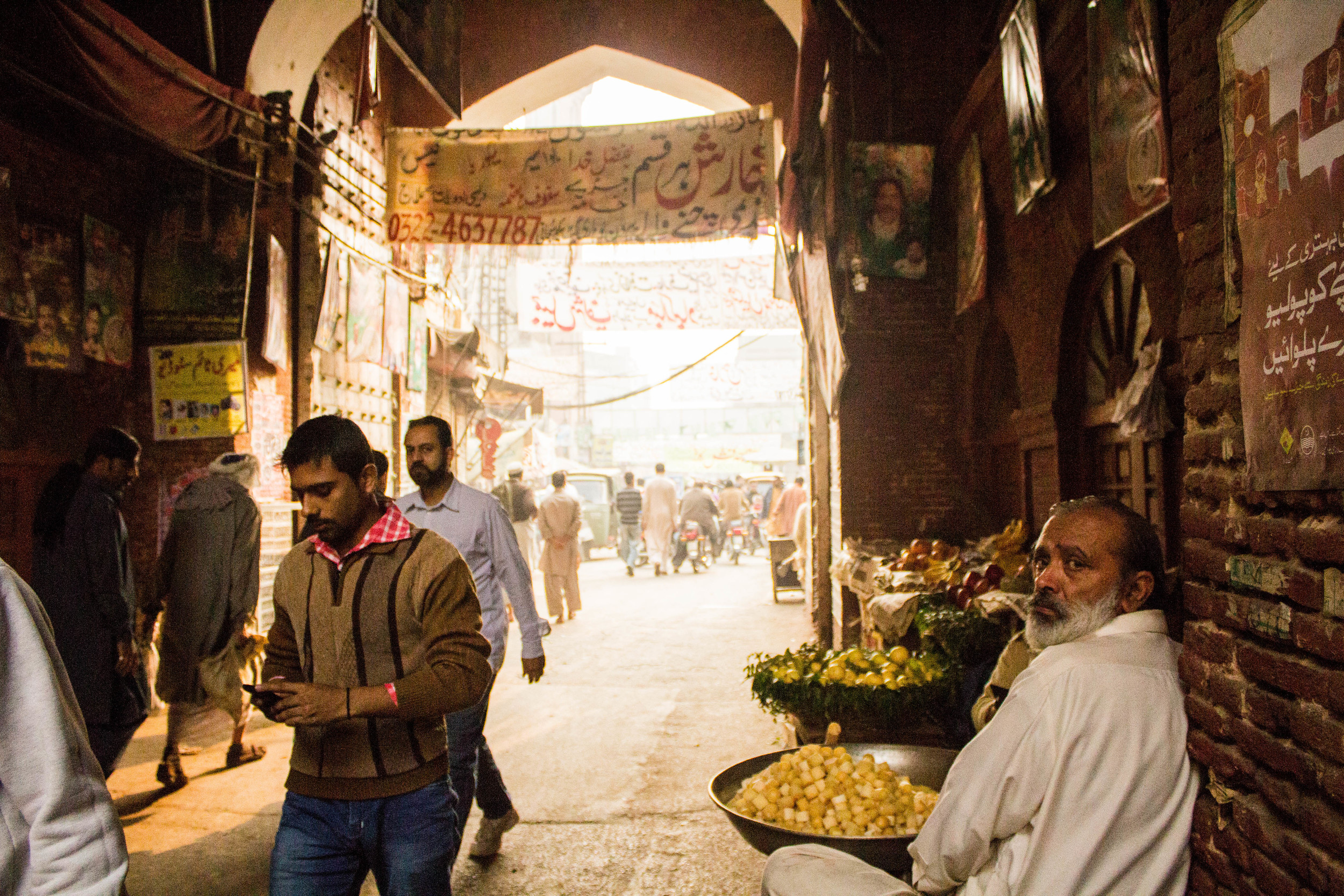 A produce seller sits just inside the Lahori gate of Old Lahore.