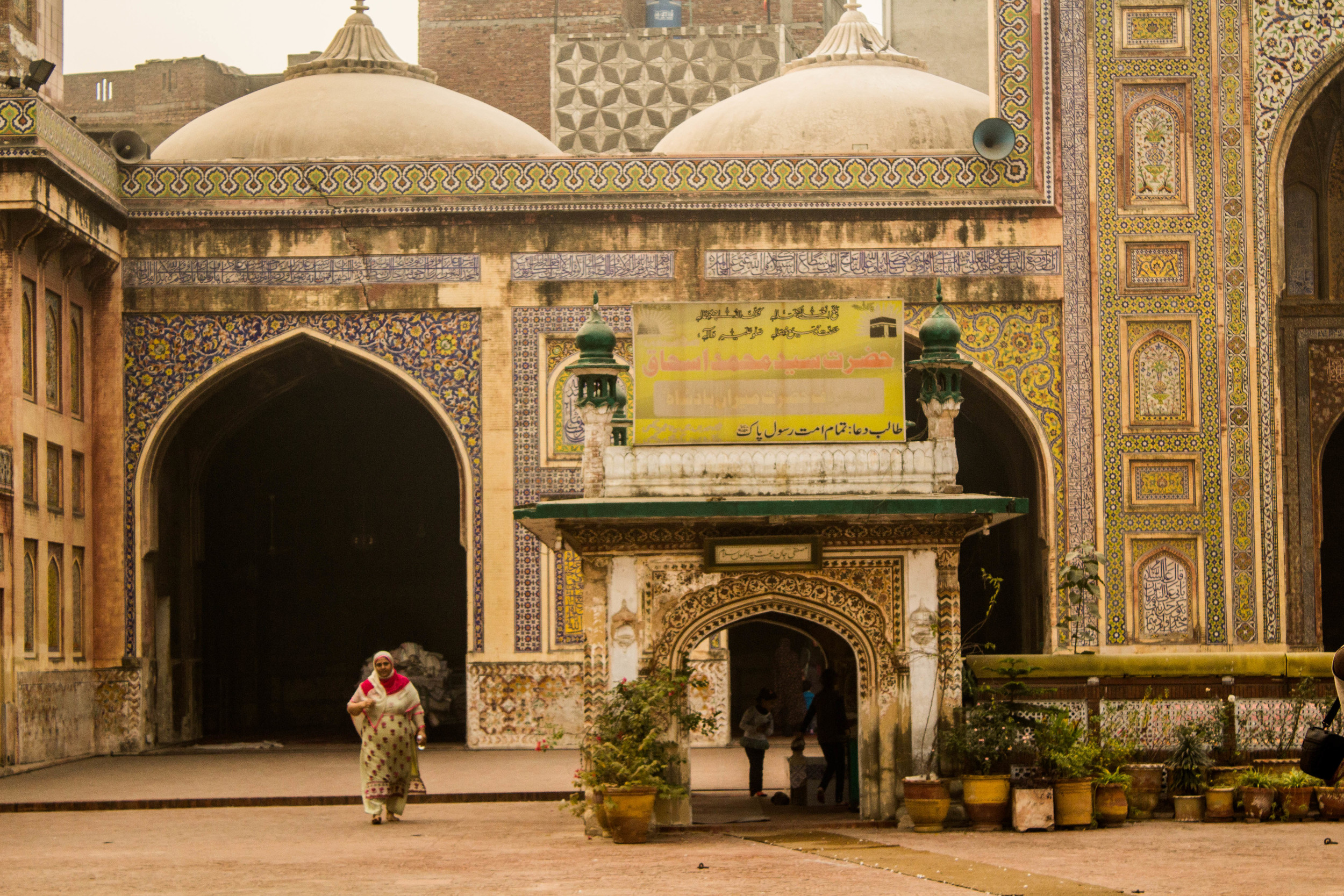 A woman strolls through the inner courtyard of the Wazir Khan Masjid inside Old Lahore.