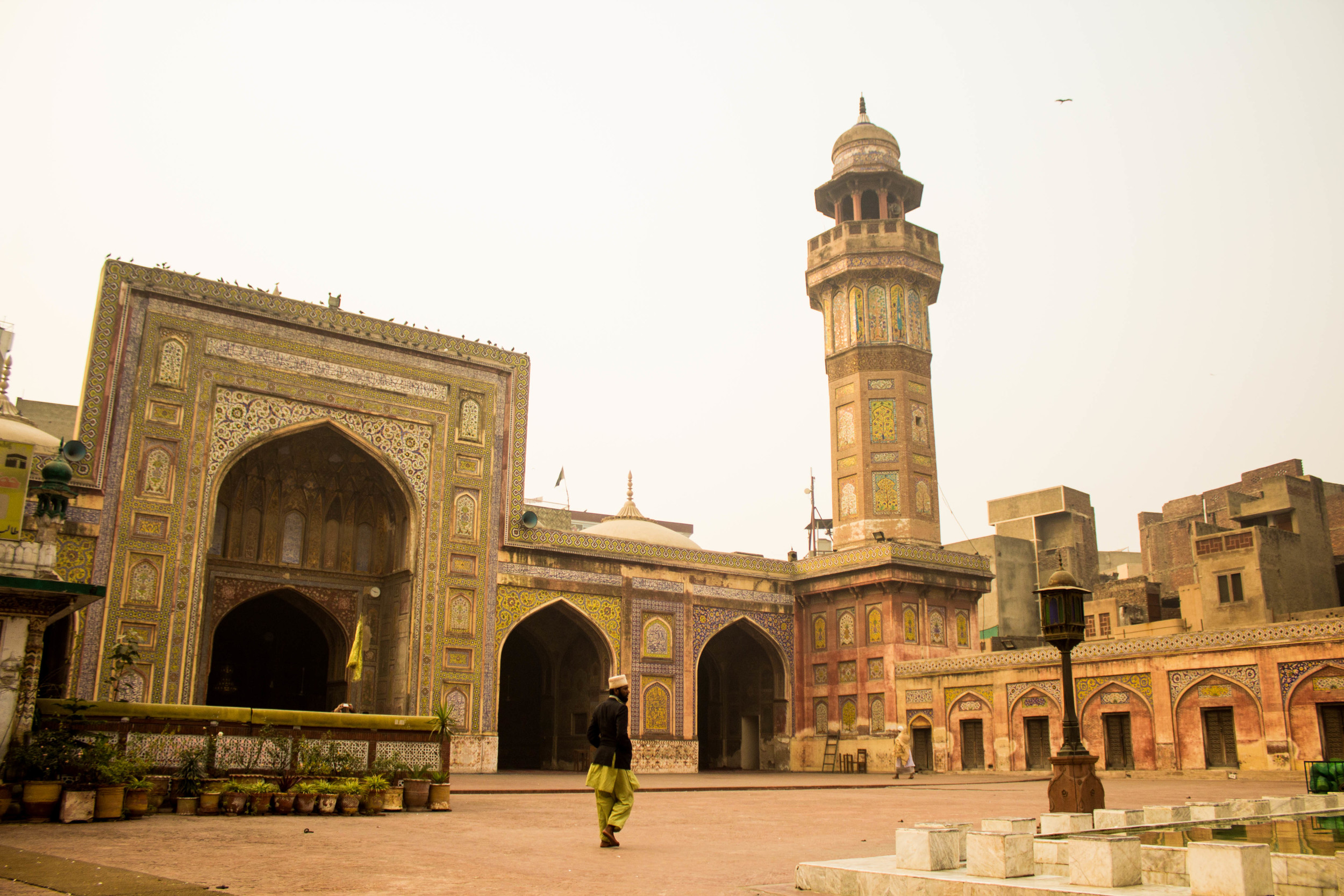 A man strolls through the inner courtyard of the Wazir Khan Masjid in Old Lahore.