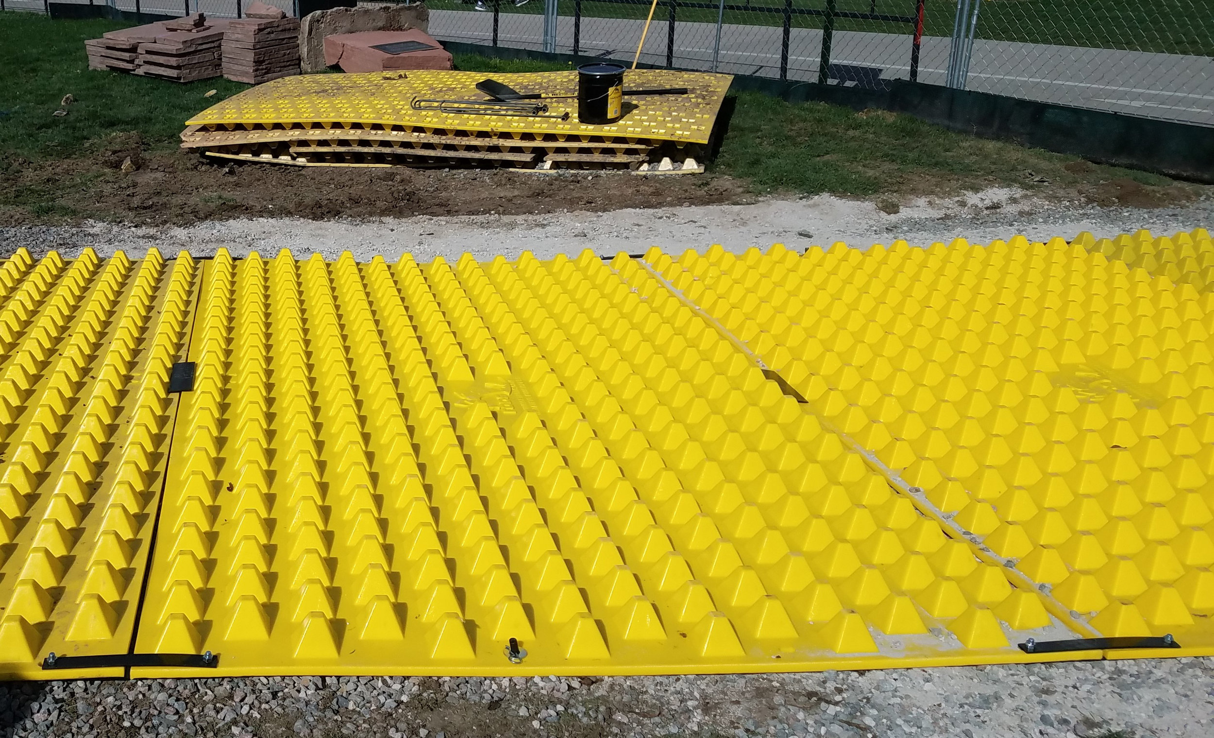FODS_CUEngineeringBusiness_expansionProjects_FODSTrackoutControlSystem_ConstructionEntranceConstructionExit_mudMats_yellowPlasticConstructionMats_BMPSWPPP.jpg